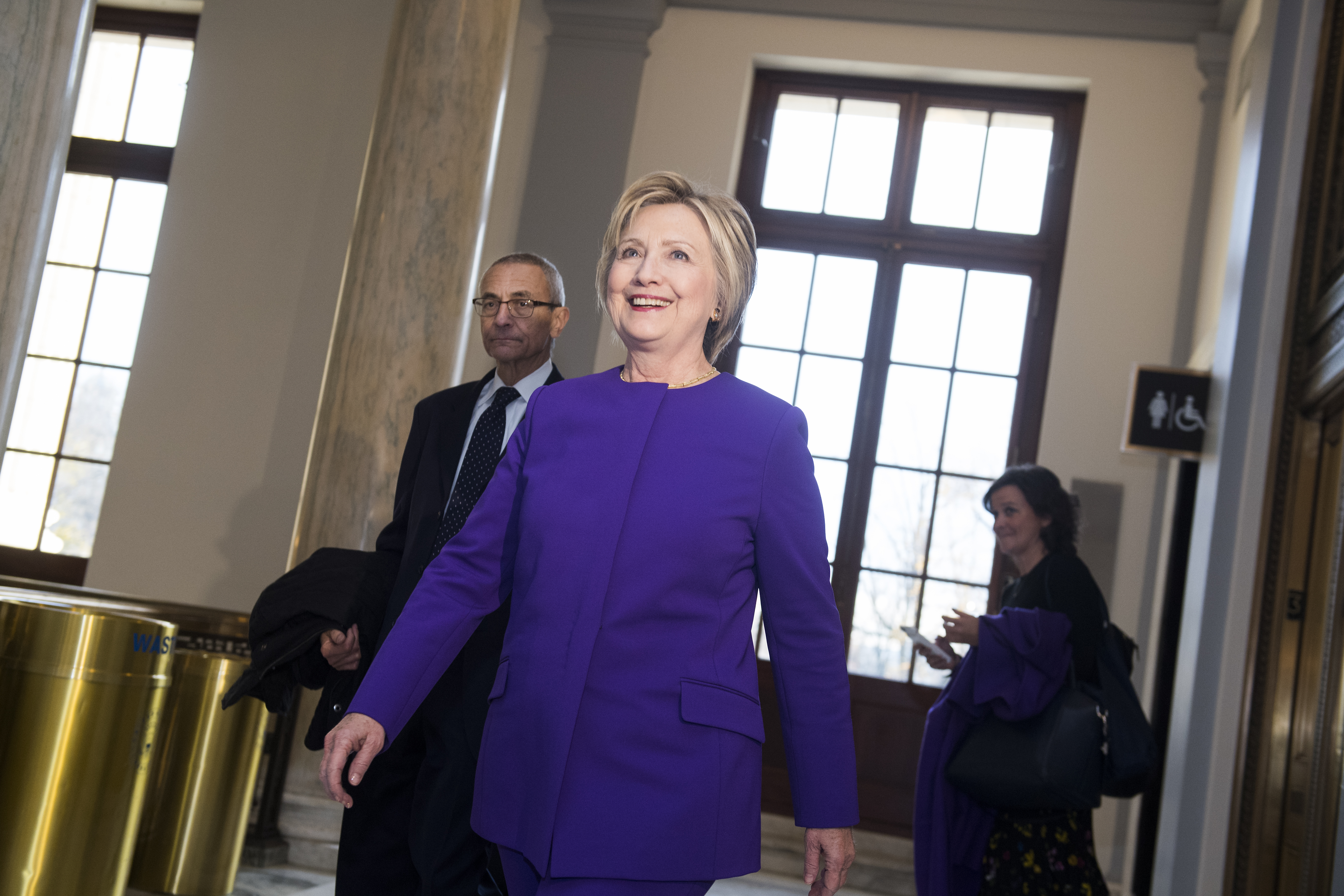 Former Secretary of State Hillary Clinton and John Podesta arrive for a portrait unveiling ceremony for retiring Senate Minority Leader Harry Reid, D-Nev., in Russell Building's Kennedy Caucus Room, December 08, 2016.