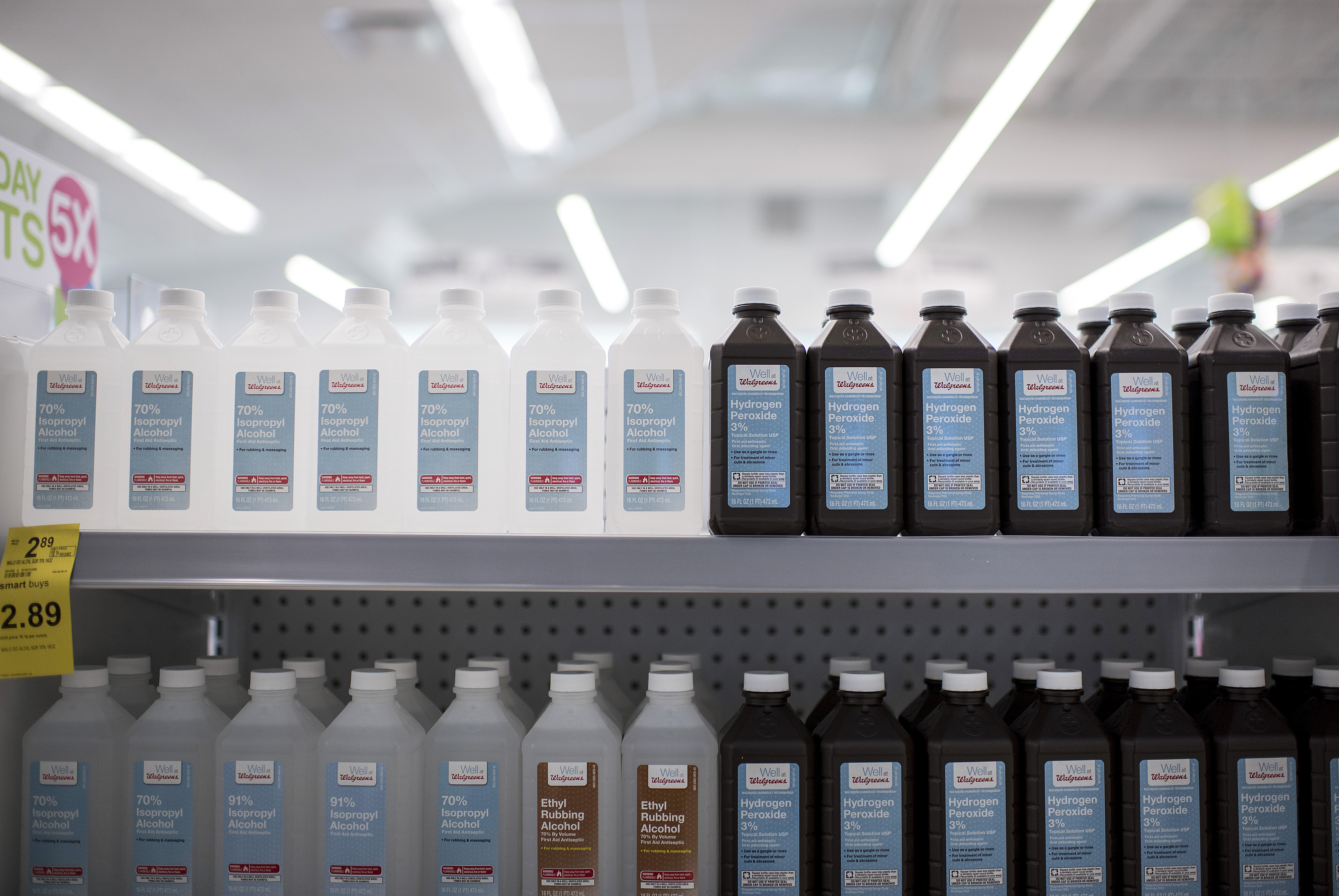 Bottles of rubbing alcohol and hydrogen peroxide are displayed for sale at a Walgreens Boots Alliance Inc. store in Elmwood Park, Illinois, U.S., on Tuesday, April 5, 2016.