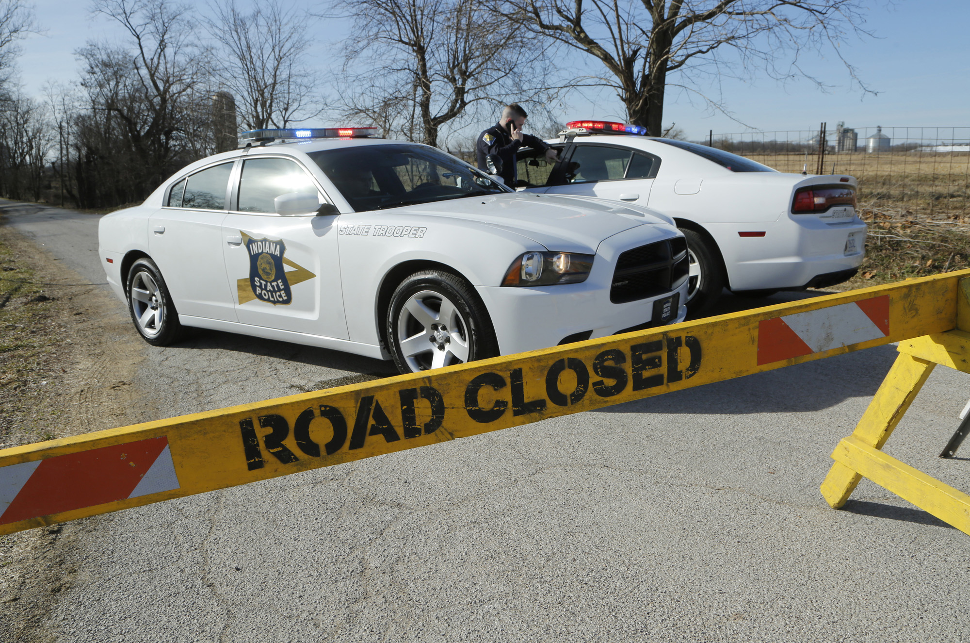 Police block the road near the intersection of Carroll County Roads North 575W and West 300N on Feb. 14, 2017, east of Delphi, Ind.
