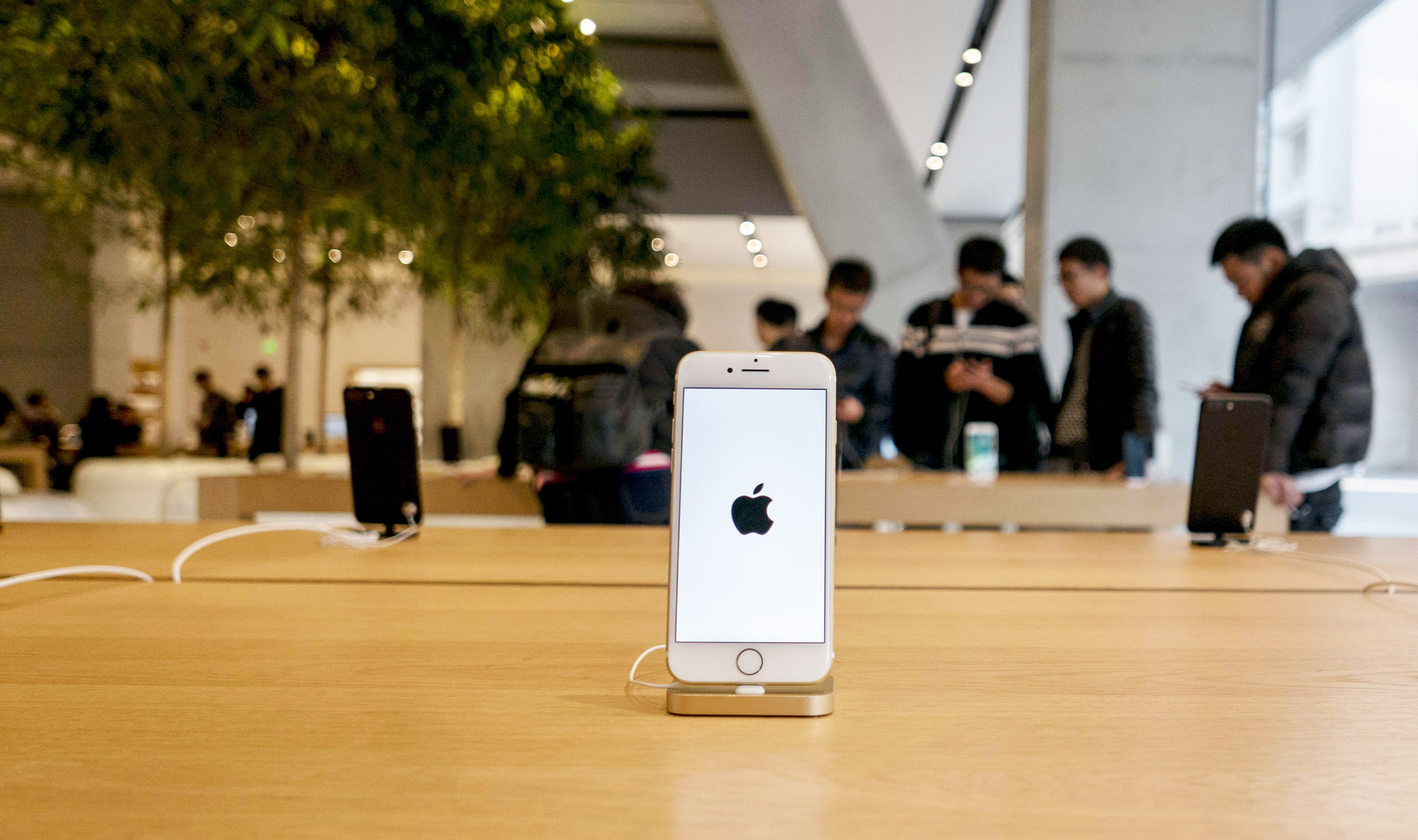 An iPhone 7 is exhibited in an Apple Store.  Because of the