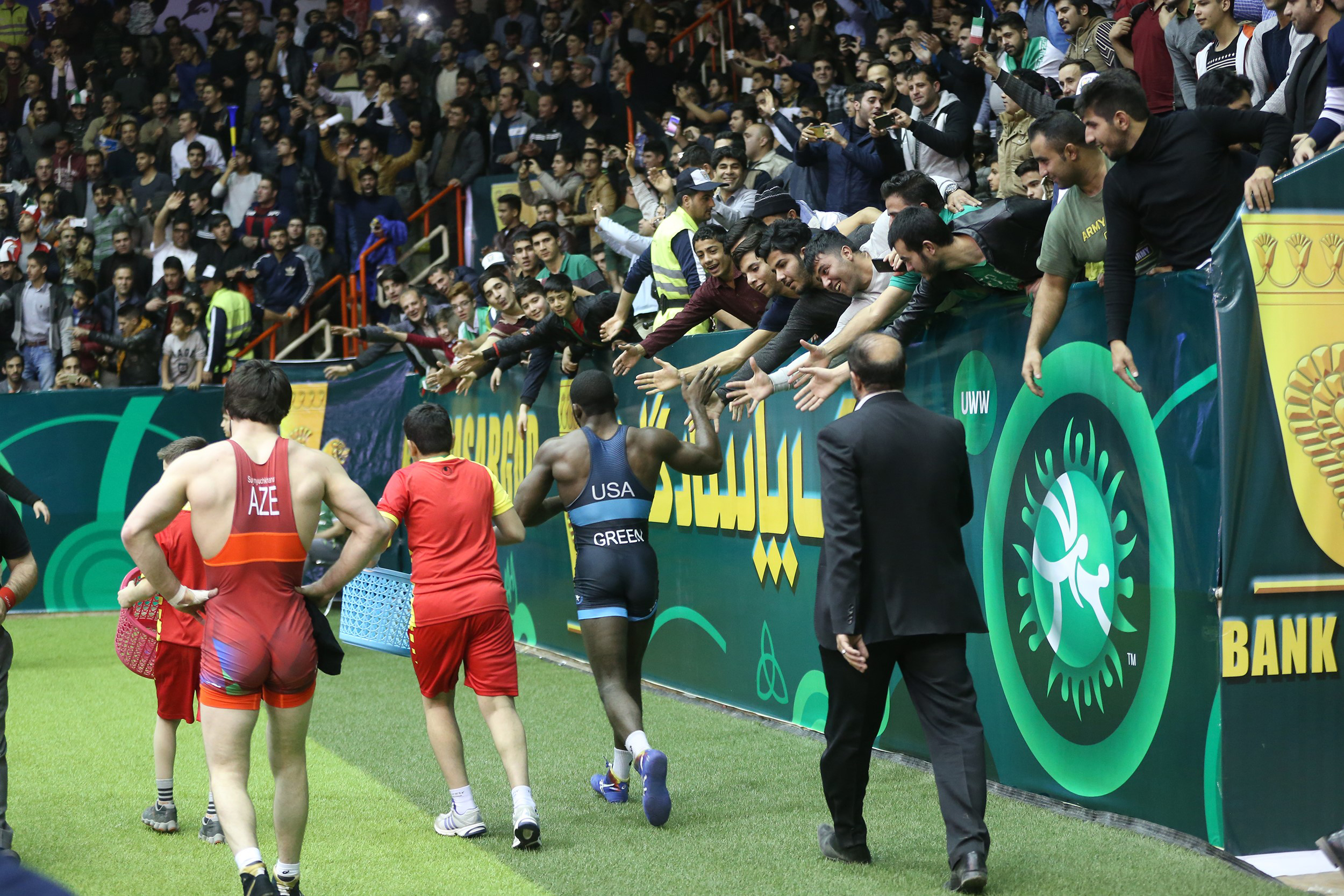 James Malcolm Green of Team USA and David Suynyuchkhanov of Azerbaijan walk after their match at the Freestyle World Cup in 74 kg at Imam Khomeini Sports Venue in Kermanshah, Iran, on Feb. 17, 2017.