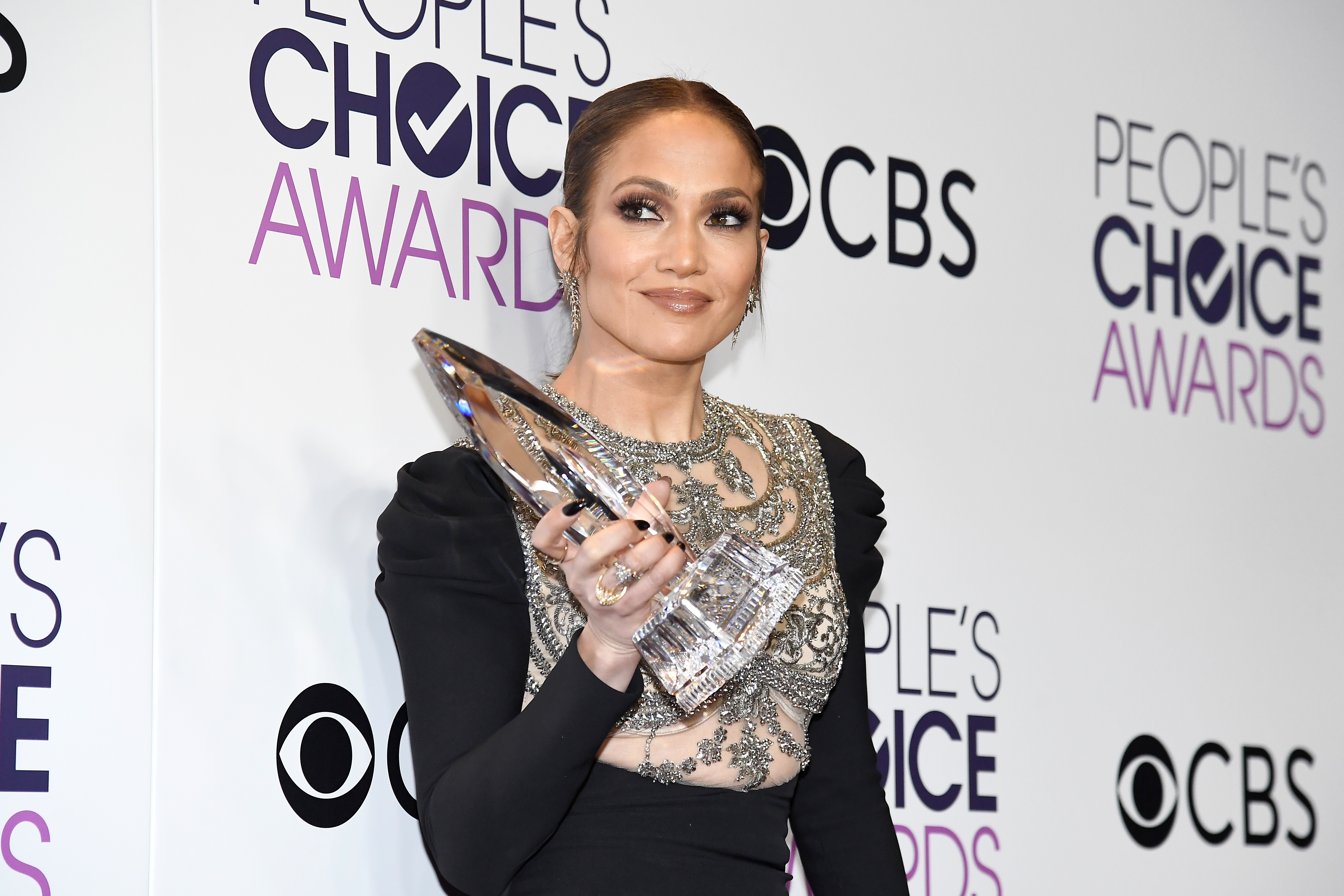 Actress/recording artist Jennifer Lopez, winner of Favorite TV Crime Drama Actress award for  Shades of Blue  poses in the press room at the People's Choice Awards 2017 at Microsoft Theater on January 18, 2017 in Los Angeles, California.