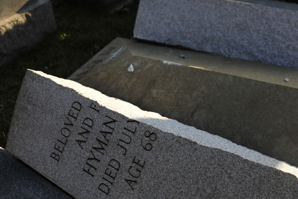 A vandalized tombstone is seen at the Jewish Mount Carmel Cemetery on Feb. 26, 2017 in Philadelphia, PA.