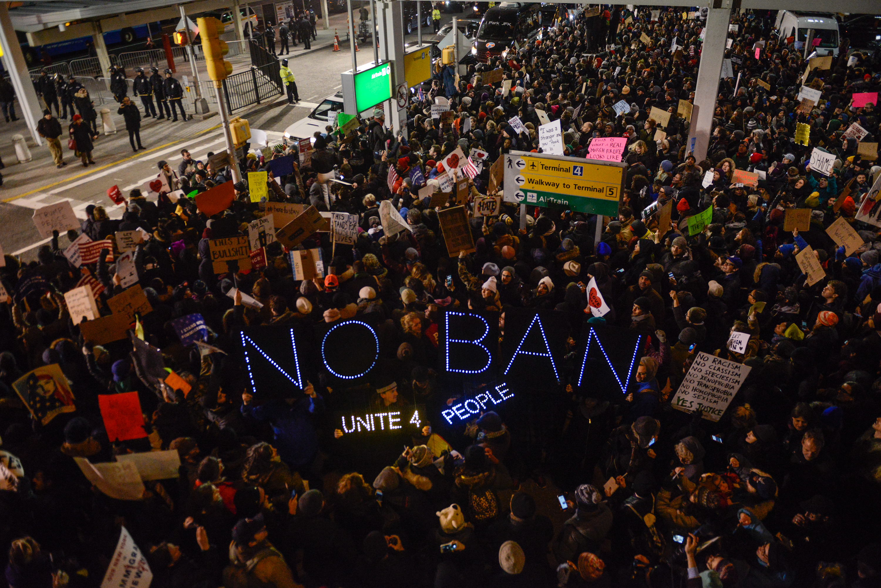 Protesters rally  during a demonstration against the Muslim immigration ban at JFK International Airport on Jan. 28, 2017, in New York City