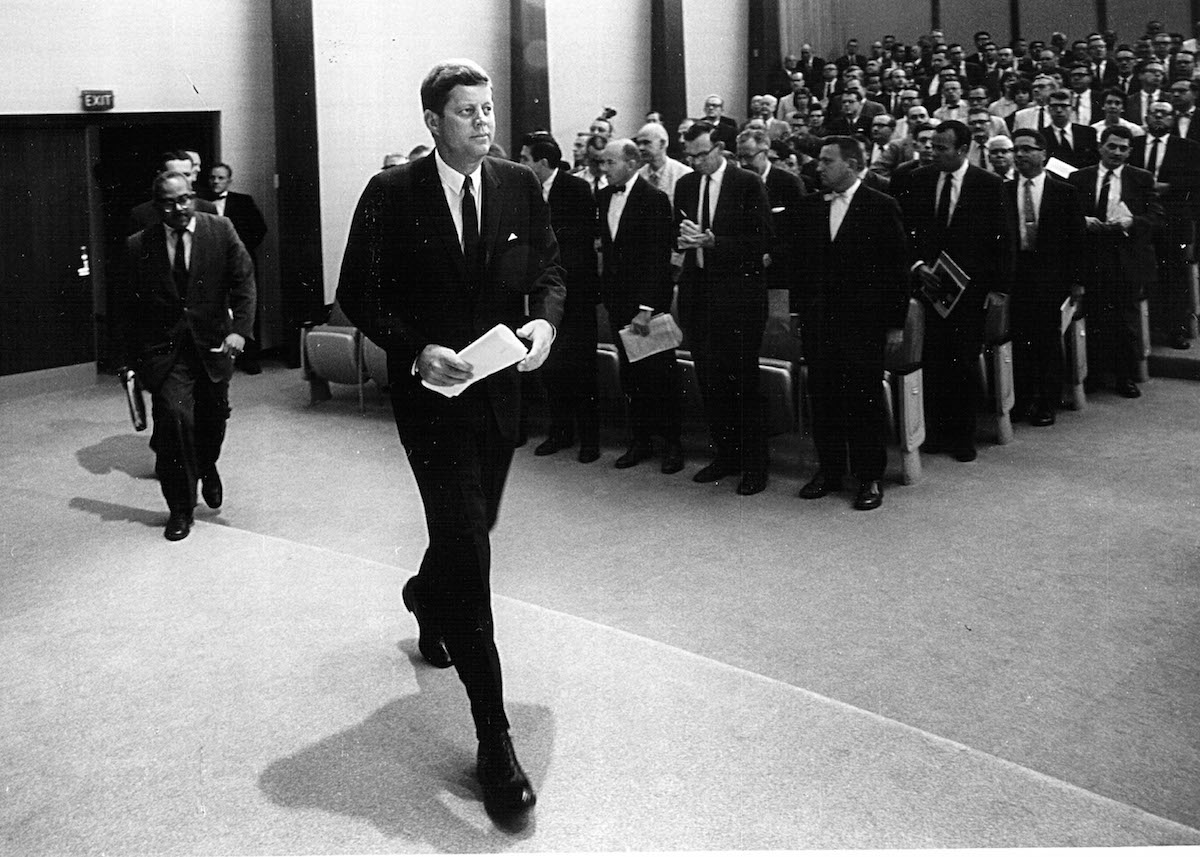 President John F. Kennedy arrives for a press conference Aug. 30, 1961 in Washington, D.C.