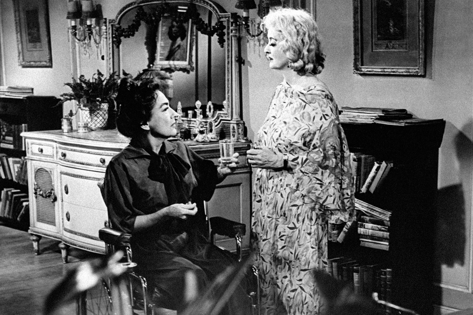 Joan Crawford and Bette Davis chatting