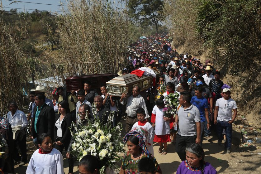 Relatives carry the caskets of two boys who were kidnapped and killed in San Juan Sacatepéquez on Feb. 14, 2017. More than 2,000 people walked in the funeral procession.