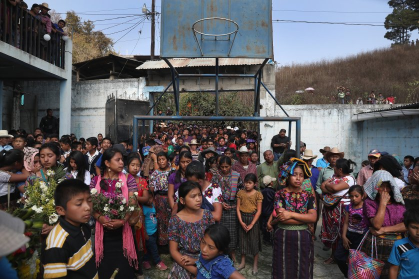 Villagers attend a memorial service held at the elementary school attended by two boys who were kidnapped and killed in San Juan Sacatepéquez on Feb. 14, 2017.