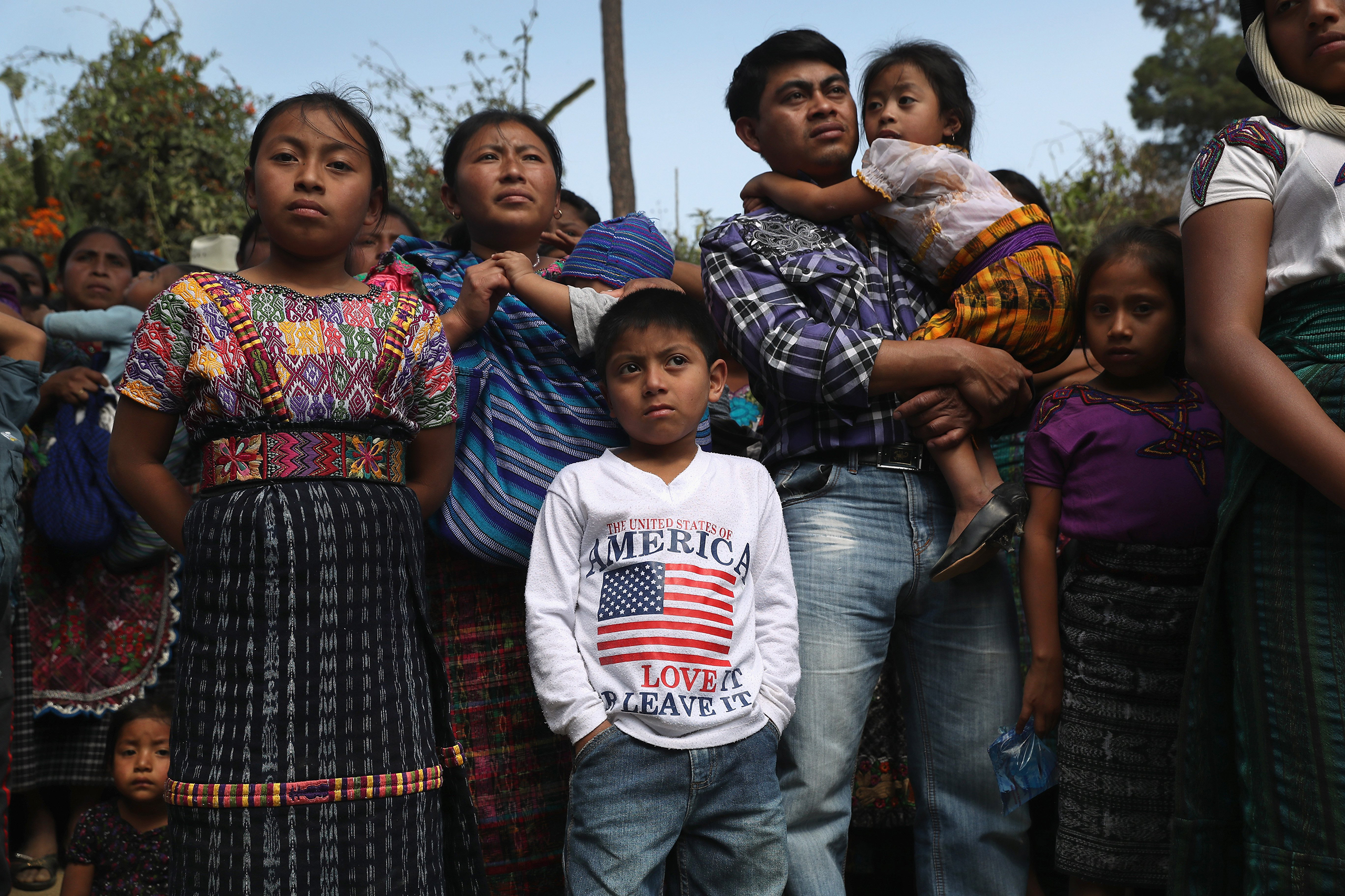 A family attends a memorial service for two boys who were kidnapped and killed in San Juan Sacatepéquez on Feb. 14, 2017.