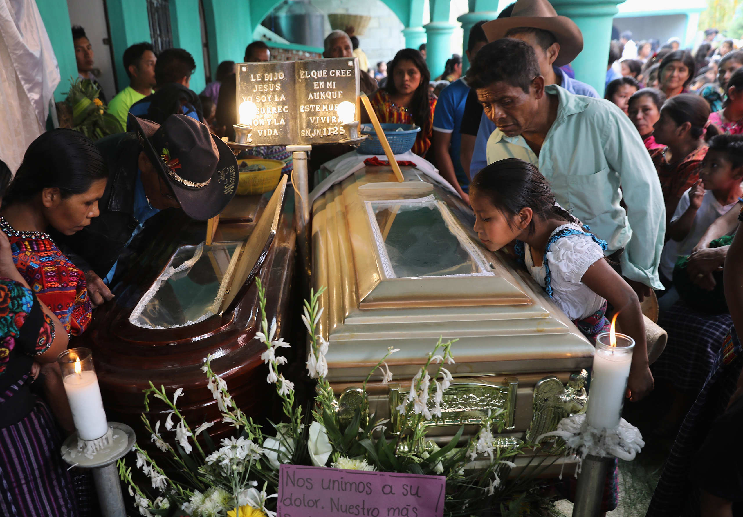 Residents attend a wake for two boys who were kidnapped and killed in San Juan Sacatepéquez on Feb. 14, 2017.