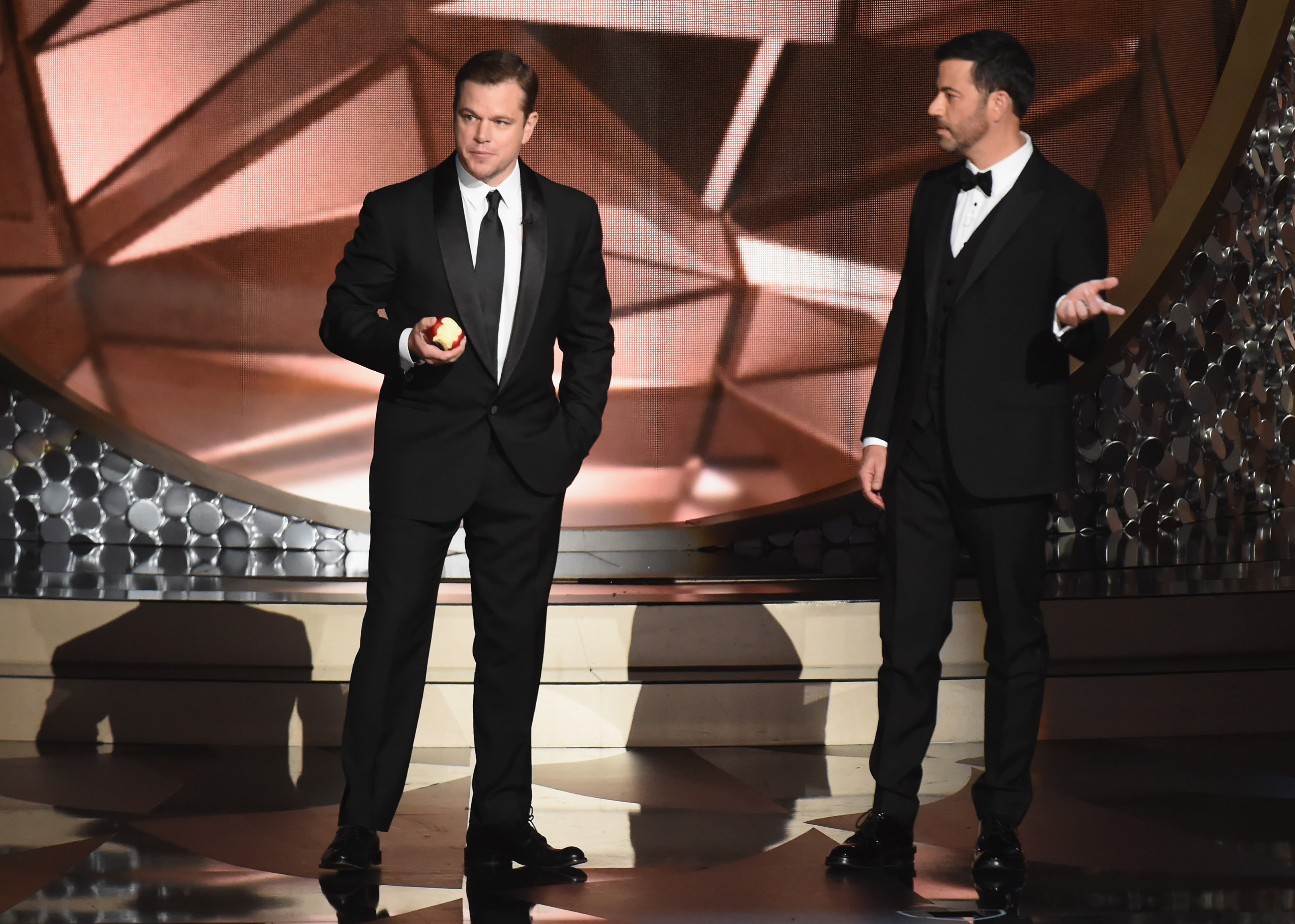 Actor Matt Damon (L) and host Jimmy Kimmel speak onstage during the 68th Annual Primetime Emmy Awards at Microsoft Theater on September 18, 2016 in Los Angeles, California.