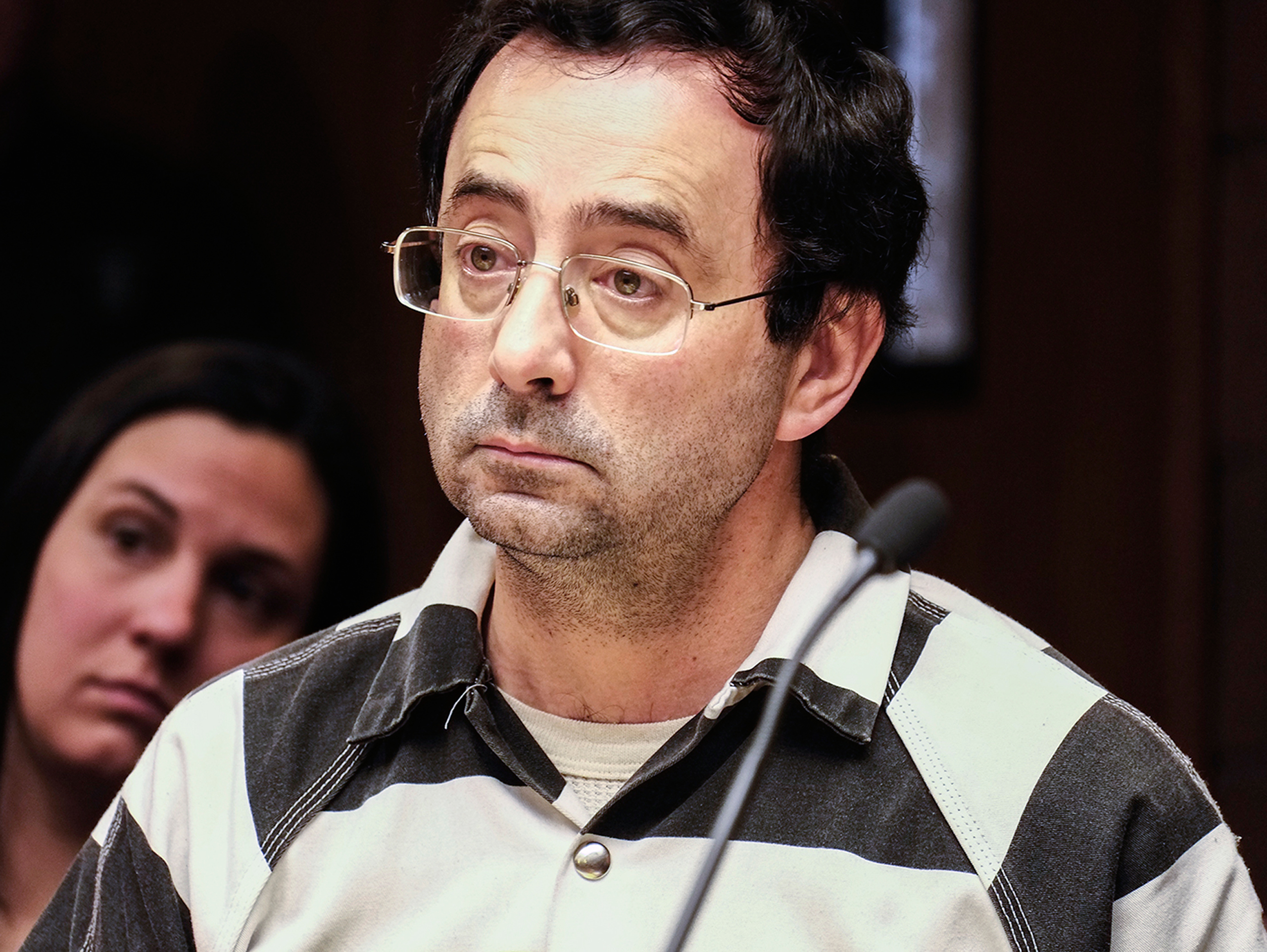Dr. Larry Nassar listens to testimony of a witness during a preliminary hearing in Lansing, Mich., on Feb. 17, 2017