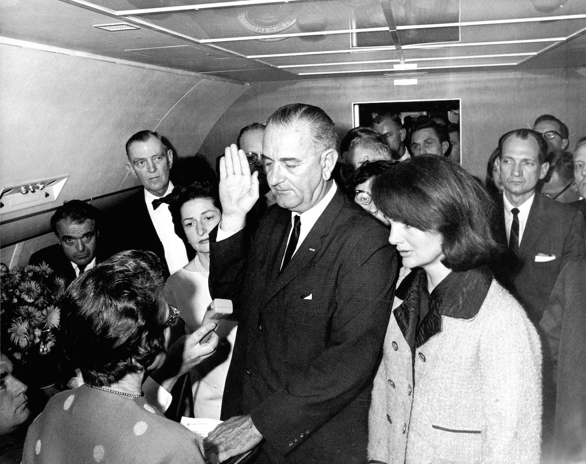 In the aftermath of the assasination of U.S. President John F. Kennedy, Lyndon Baines Johnson takes the oath of office to become the 36th President of the United States, on  Air Force One, Dallas, Nov. 22, 1963.