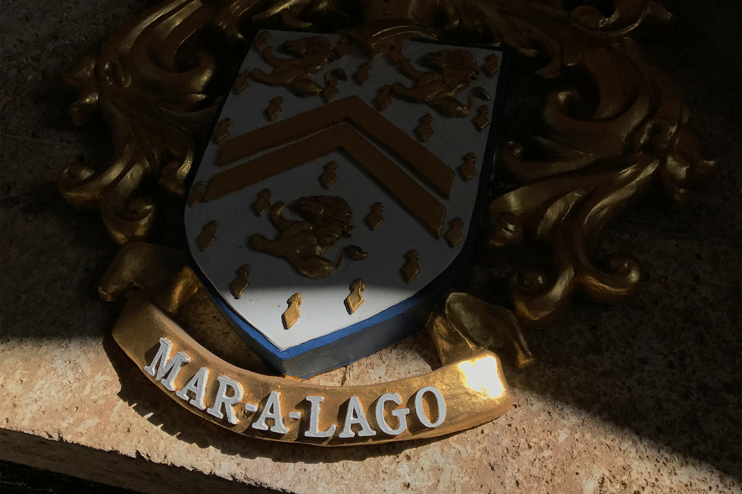 Sunlight illuminates part of a coat of arms at the Mar-a-Lago Club in Palm Beach, Florida, on December 28, 2016.