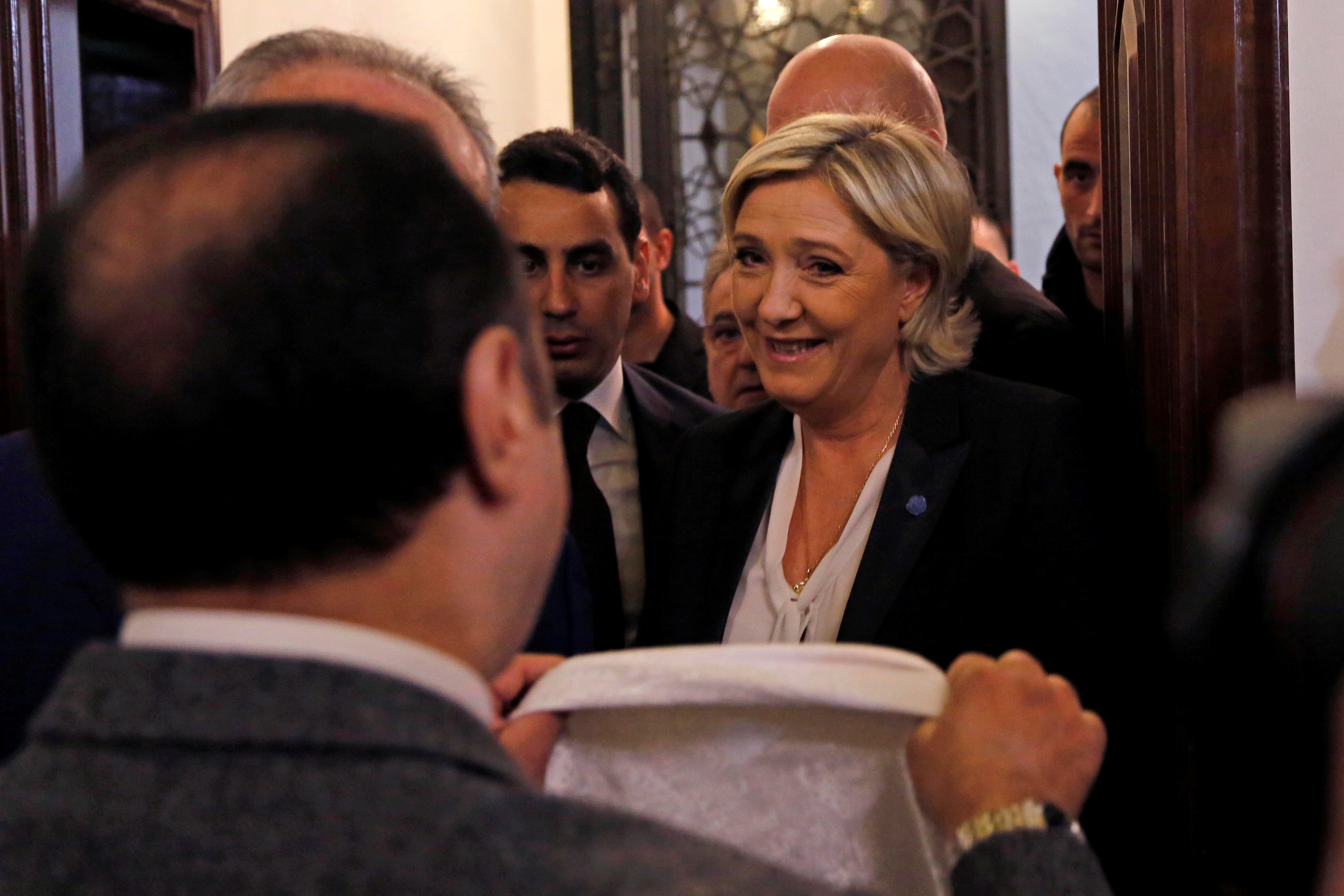 The leader of France's far-right Front National political party and presidential candidate, Marine Le Pen (C) refuses to wear headscarf before her meeting with Lebanon's Grand Mufti Sheikh Abdul Latif Derian, in Beirut, Lebanon on February 21, 2017.