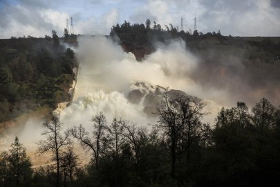 65,000 cfs of water flows through a damaged spillway on the Oroville Dam in Oroville, California on Feb. 10, 2017.