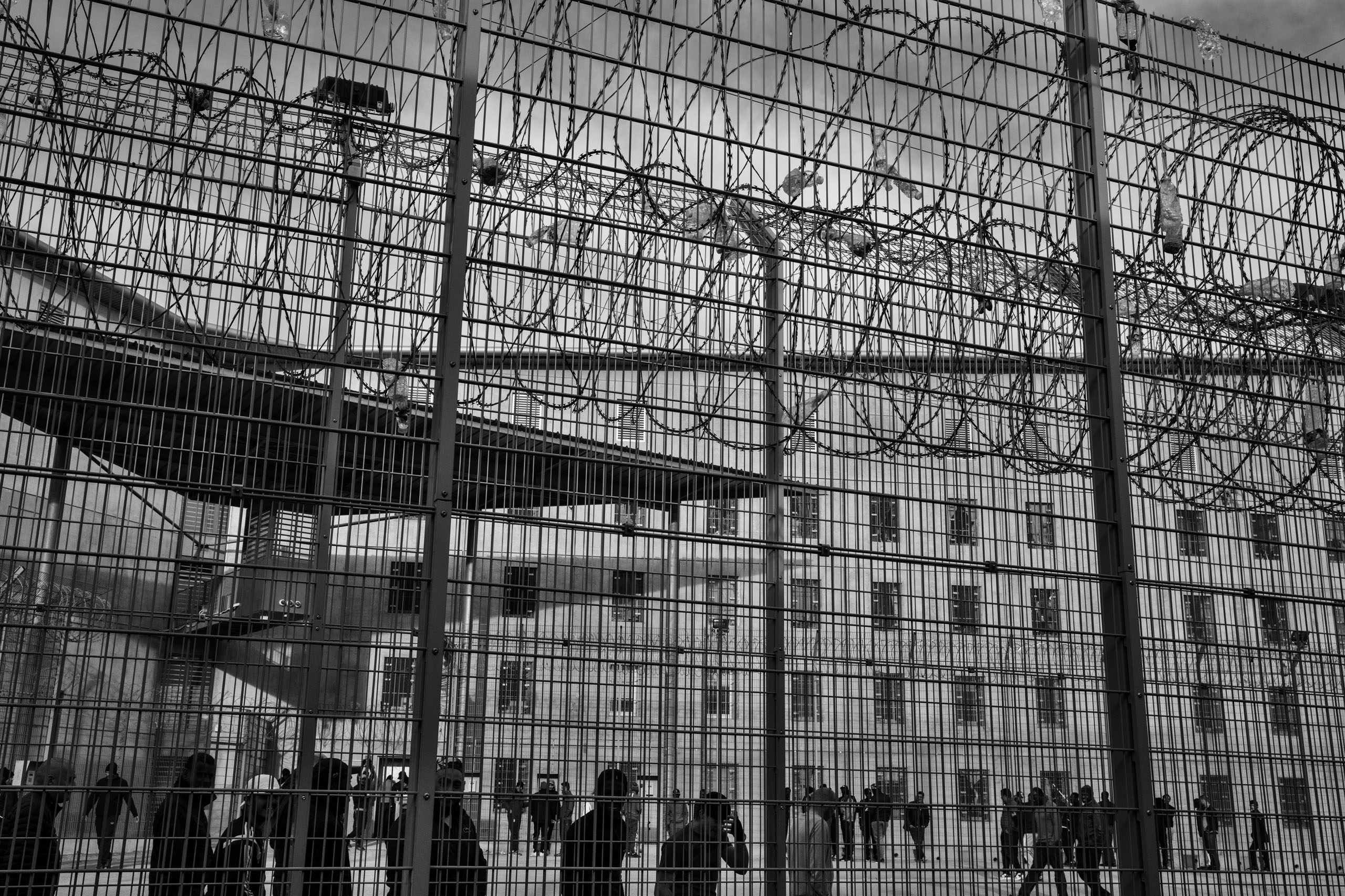 Prisoners walk in the courtyard of the Meaux-Chauconin penitentiary, 35 miles northeast of Paris, Nov. 24, 2016,   Overcrowding in French prisons, in which over half the population is estimated to be Muslim, is a serious political issue in France.