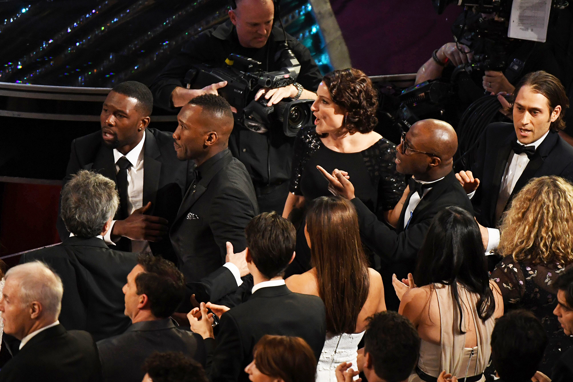 The cast and crew of Moonlight react after they won the Best Picture Oscar, on Feb. 26, 2017 in Hollywood, Calif.
