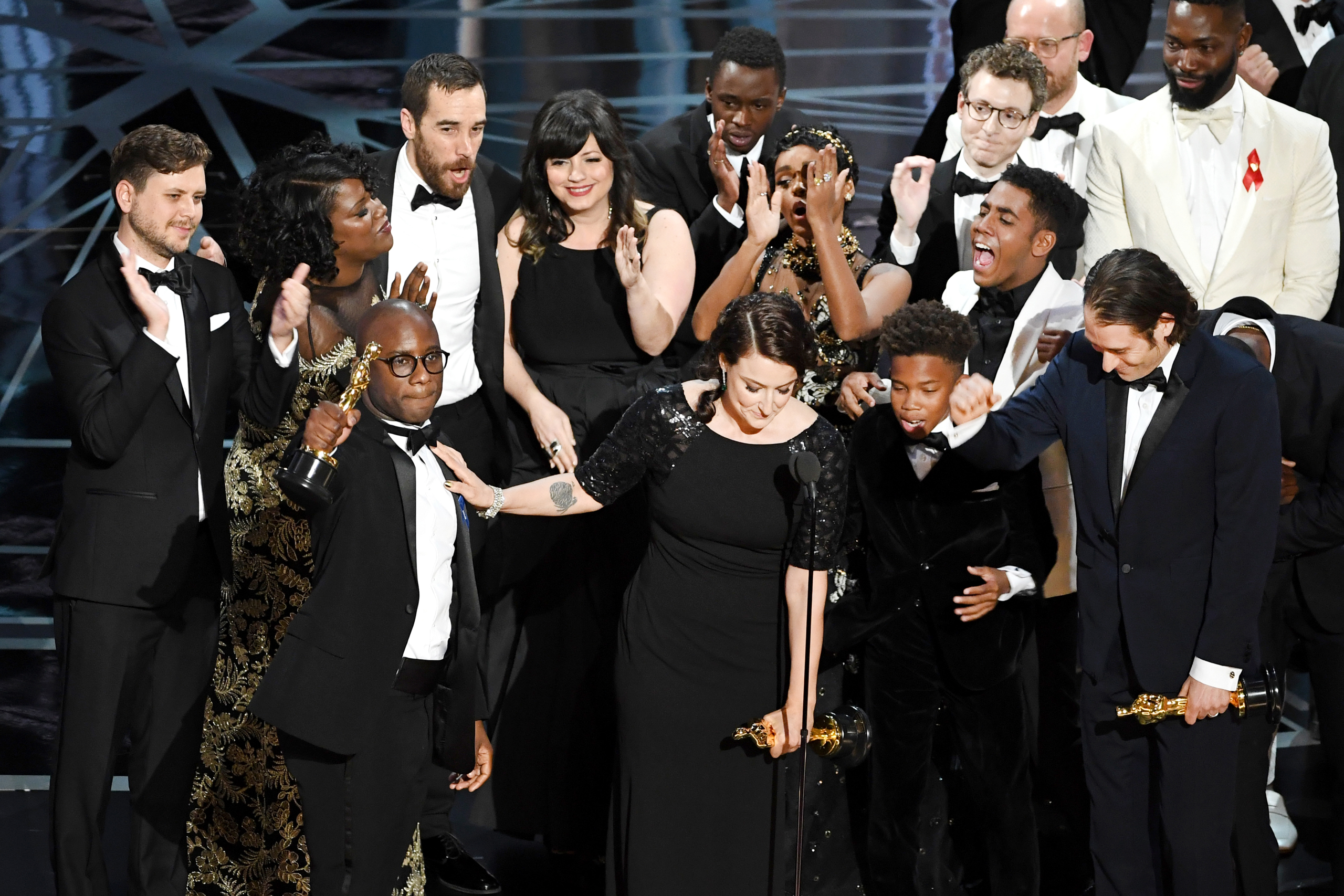 Producer Adele Romanski (C), writer/director Barry Jenkins, producer Jeremy Kleiner and cast/crew members accept Best Picture for 'Moonlight' onstage during the 89th Annual Academy Awards at Hollywood Highland Center on Feb. 26, 2017.