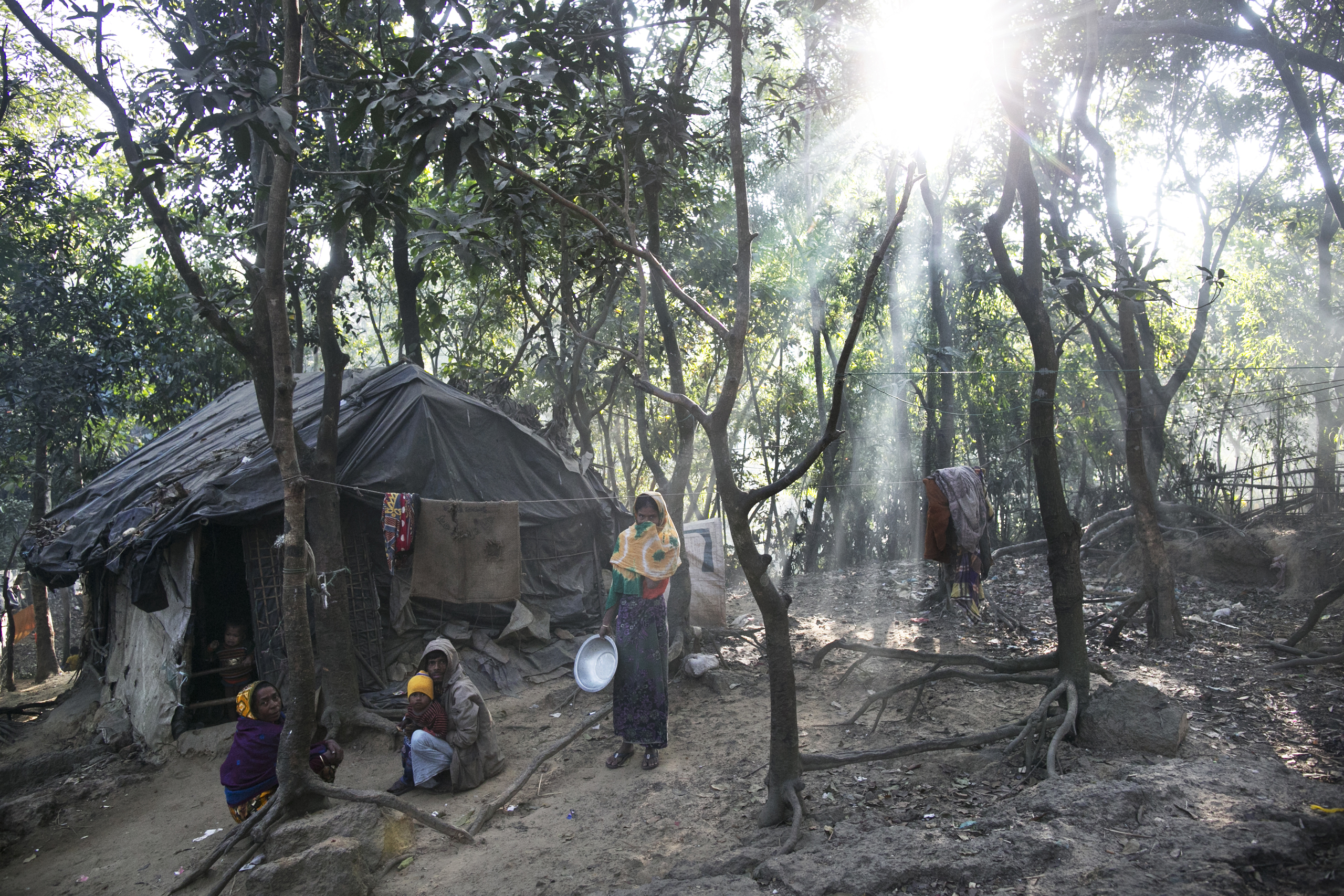People are seen in the Kutapalong Rohingya refugee camp in Cox's Bazar, Bangladesh, on Jan. 21, 2017. More than 65,000 Rohingya Muslims have fled to Bangladesh from Myanmar since October last year, after the Burmese army launched a campaign it calls  clearance operations  in response to an attack on border police on October 9, believed to have been carried out by Rohingya militants.