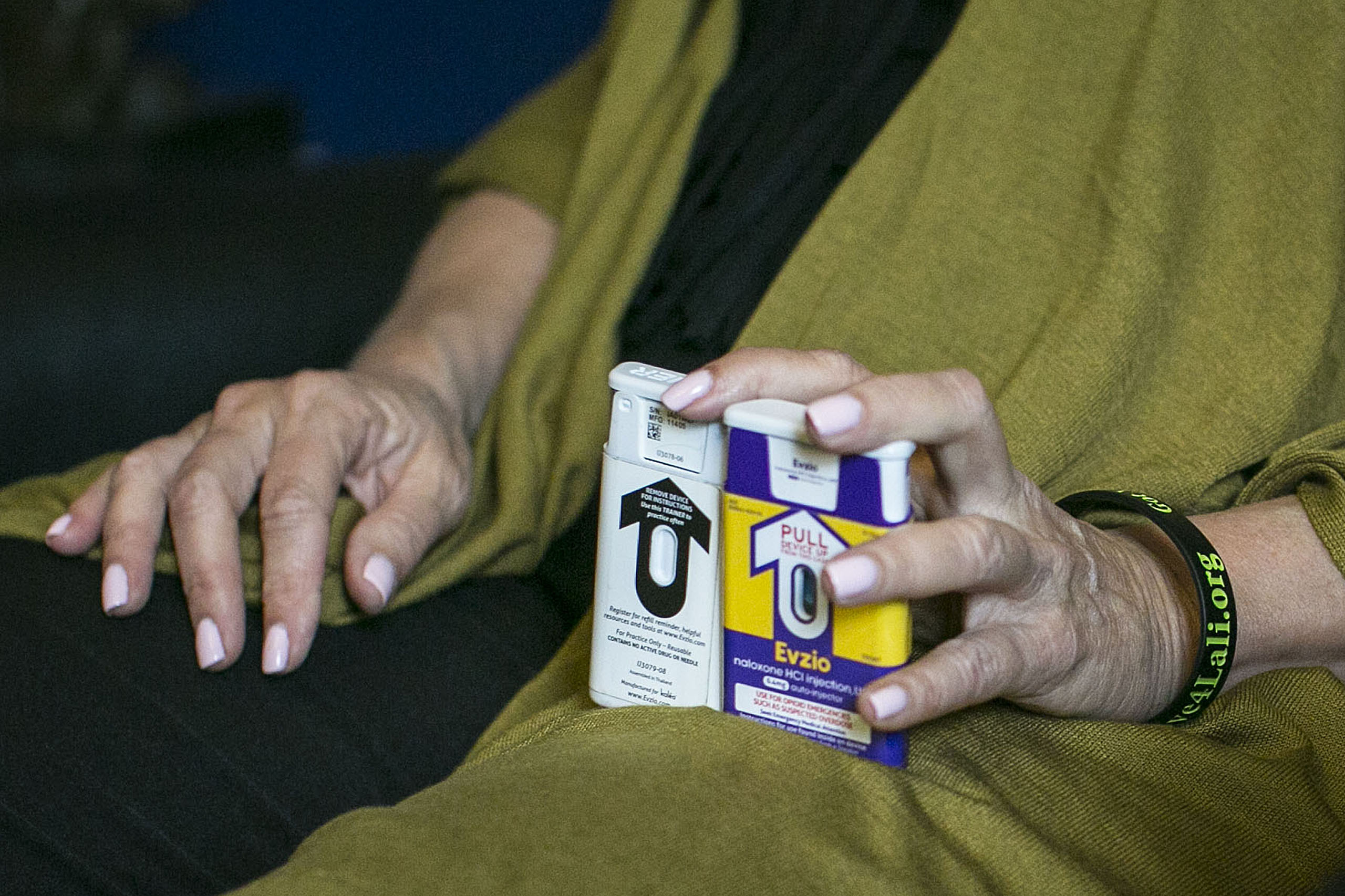 Jody Daitchman holds two versions of Naloxone, also known as Narcan, which combat drug overdoses, in Washington, on May 11, 2016.
