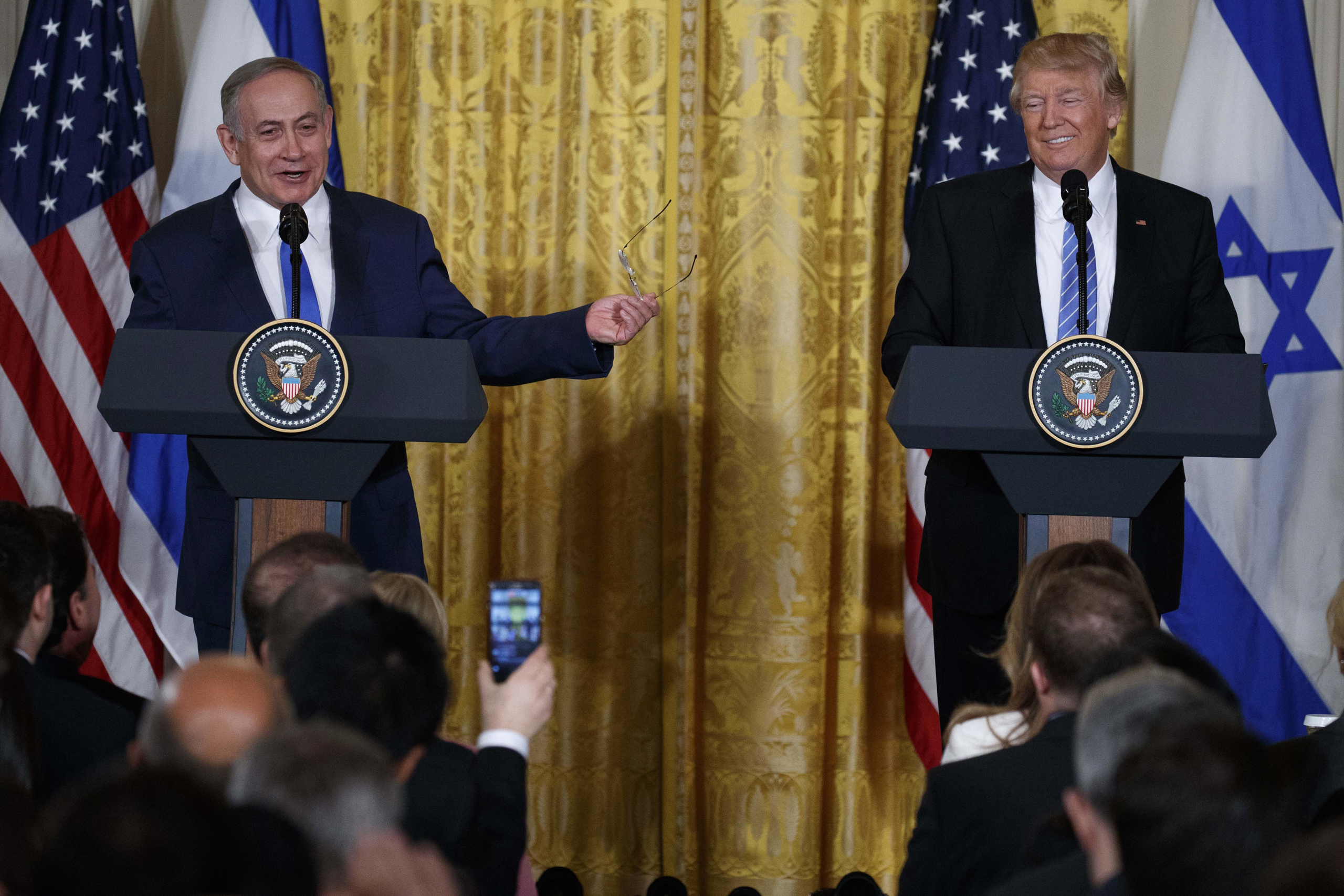 President Donald Trump listens as Israeli Prime Minister Benjamin Netanyahu speaks during their joint news conference in the East Room of the White House, on Feb. 15, 2017.
