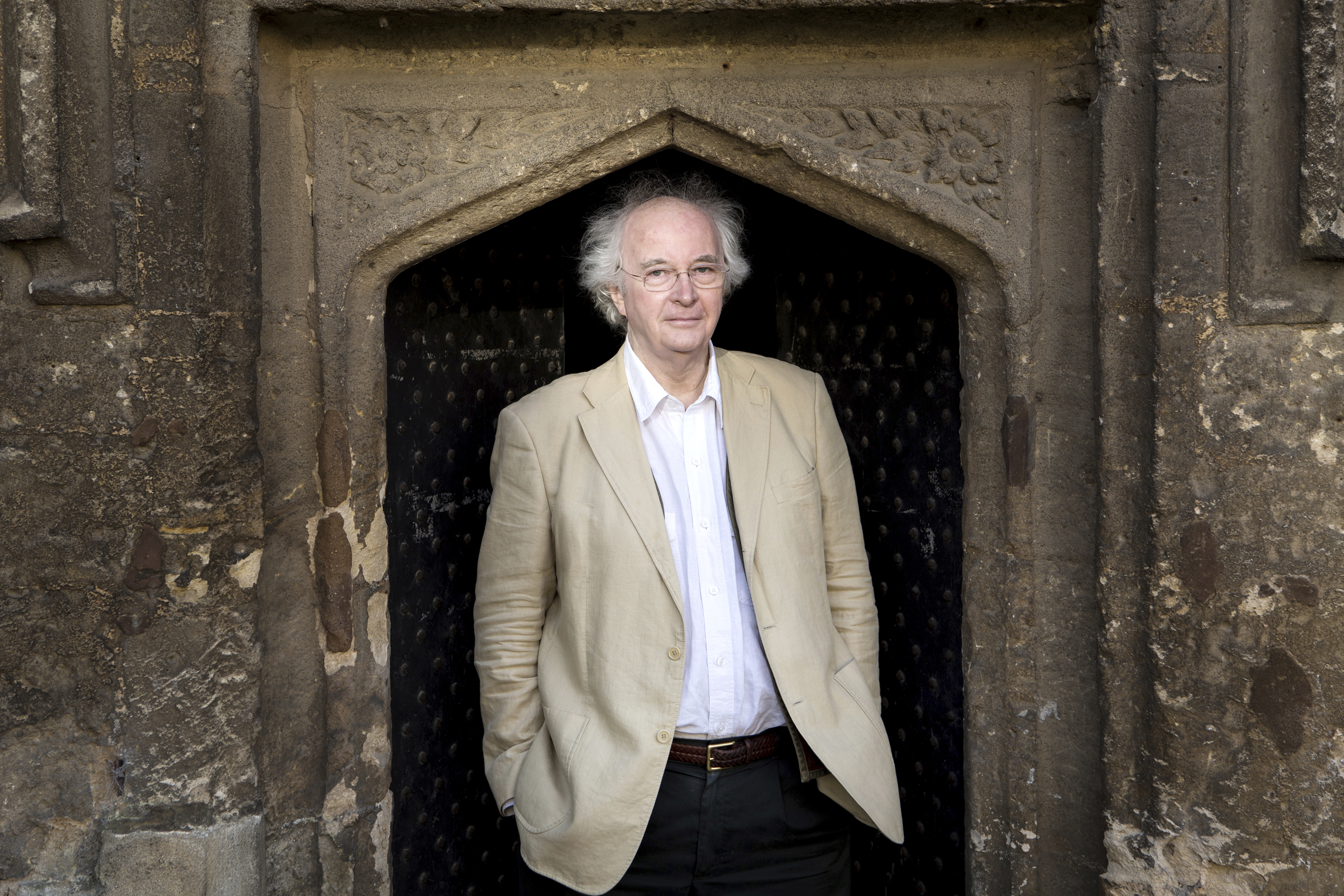 Philip Pullman poses for a photograph outside of Worcester College, in Oxford, England on Jan. 11, 2017.