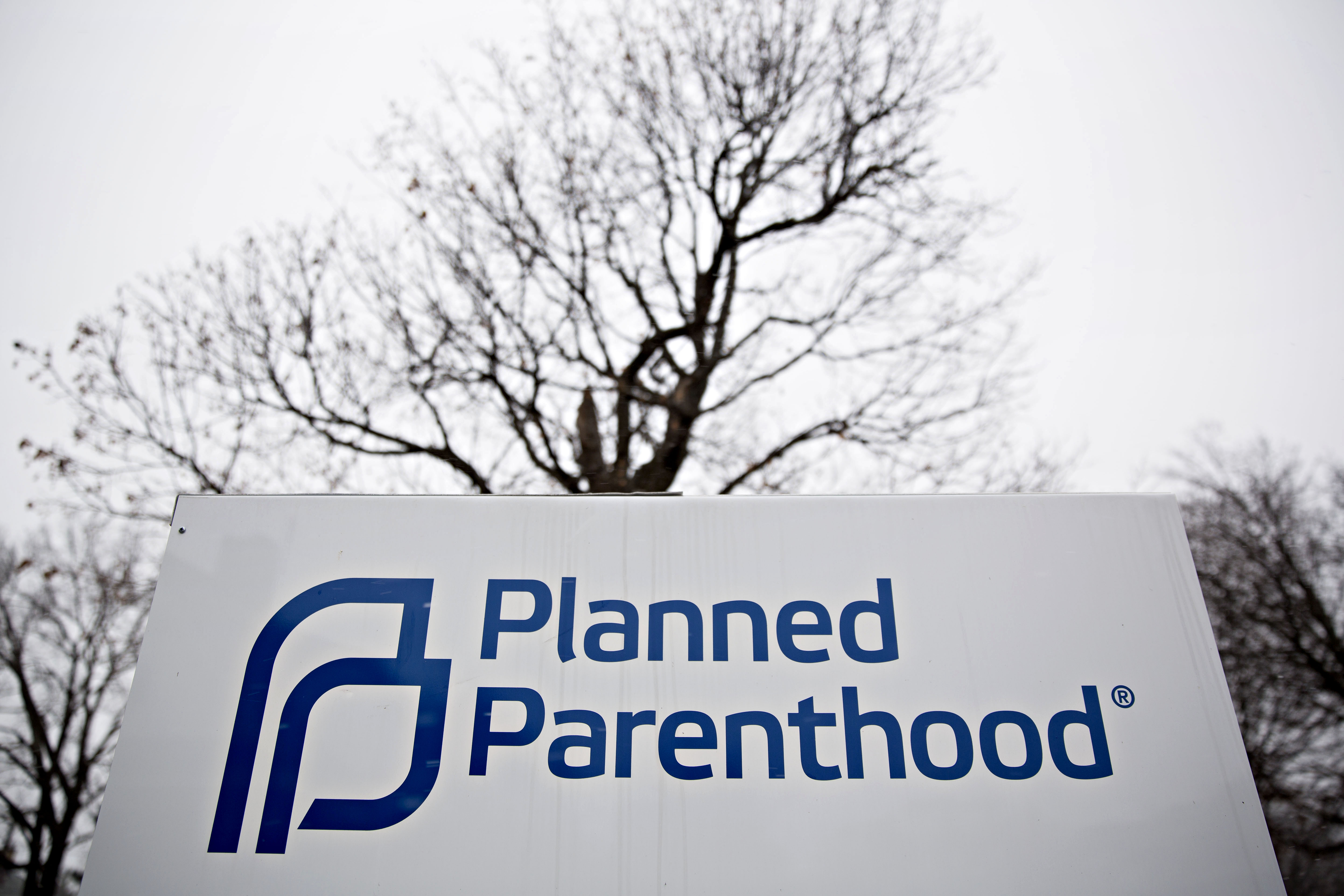 Signage is displayed outside a Planned Parenthood office in Peoria, Illinois, U.S., on Friday, Dec. 16, 2016. Republicans are thinking ahead to regulations Obama might still try to complete before he leaves office, including a pending rule barring states from blocking funds to Planned Parenthood. Photographer: Daniel Acker/Bloomberg via Getty Images