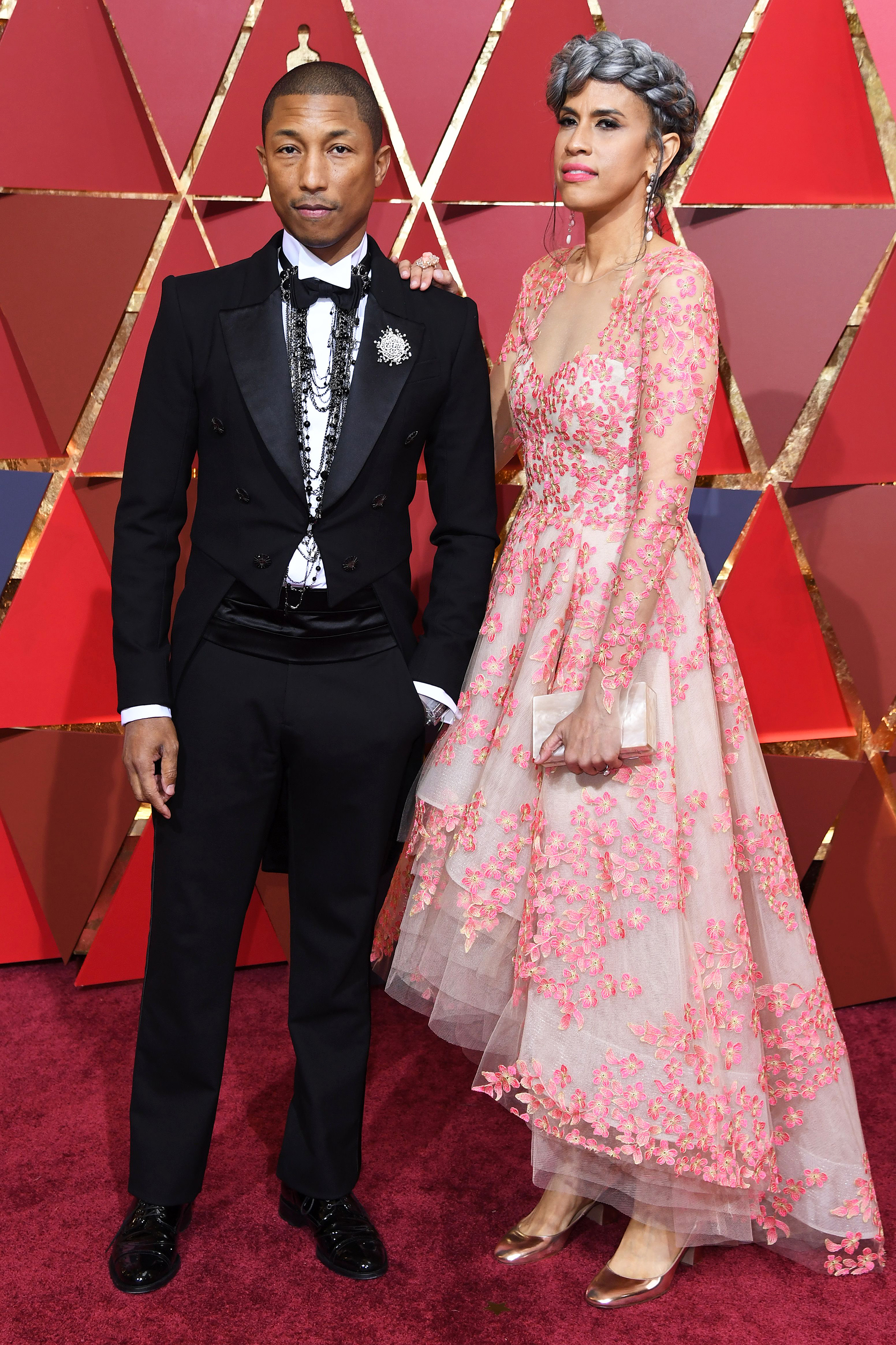 Pharrell Williams and Helen Lasichanh on the red carpet for the 89th Oscars, on Feb. 26, 2017 in Hollywood, Calif.