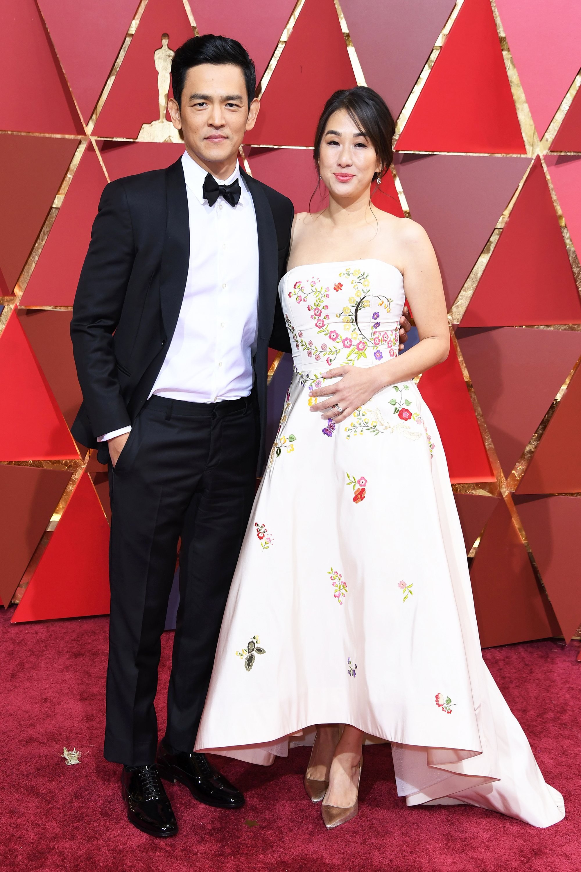 Kerri Higuchi and John Cho on the red carpet for the 89th Oscars, on Feb. 26, 2017 in Hollywood, Calif.