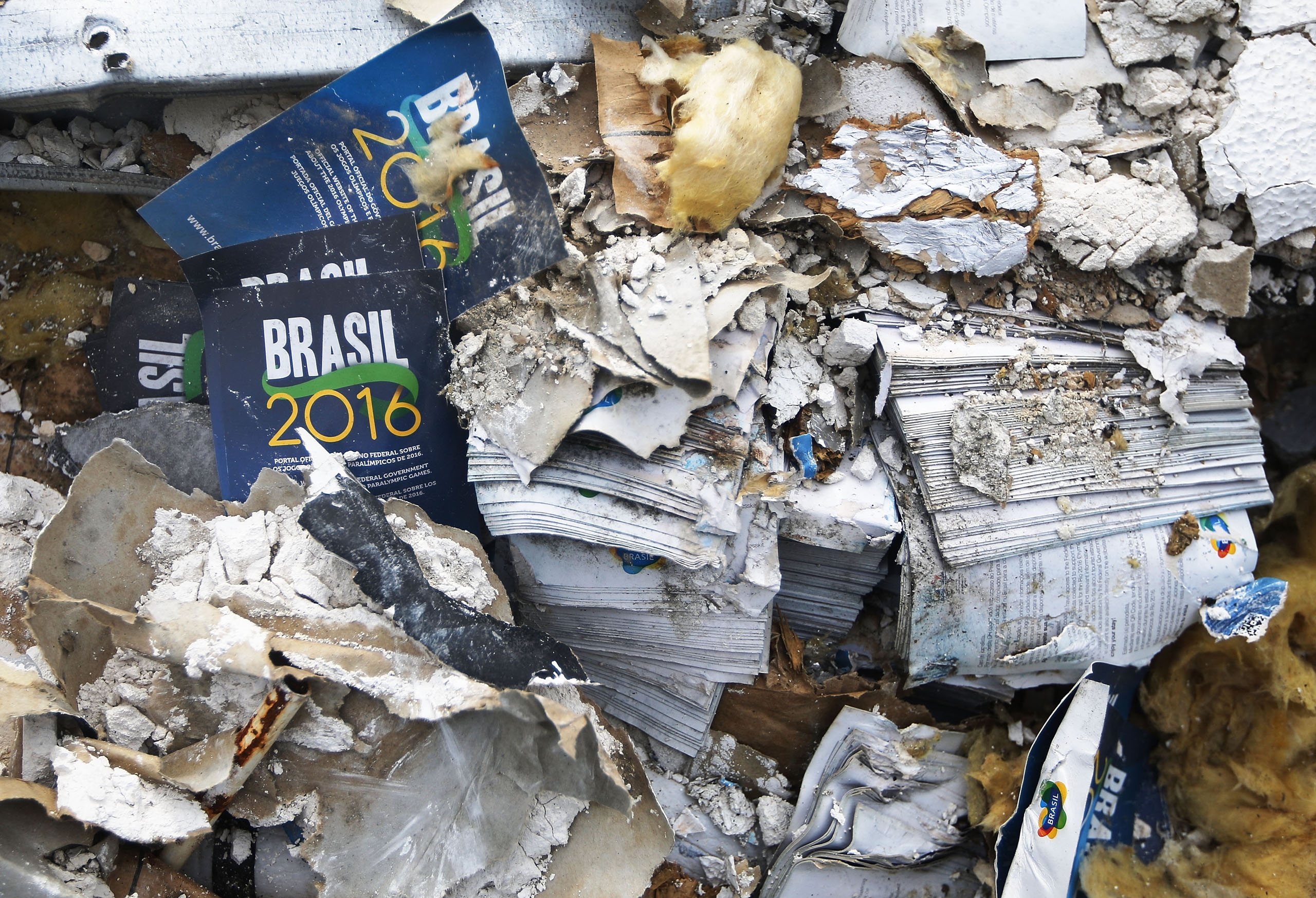 Media pamphlets sit among the demolished remains of the former Rio Media Center, constructed to host some visiting media for the Rio 2016 Olympic Games, on Nov. 21, 2016.
