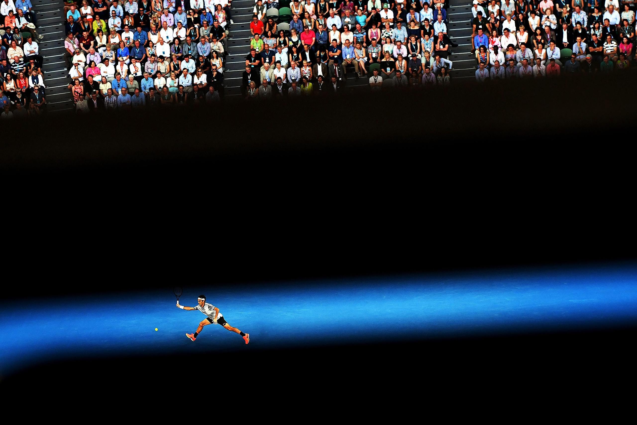 Federer outlasted longtime rival Rafael Nadal in five grueling sets to win the Australian Open in Melbourne on Jan. 29.