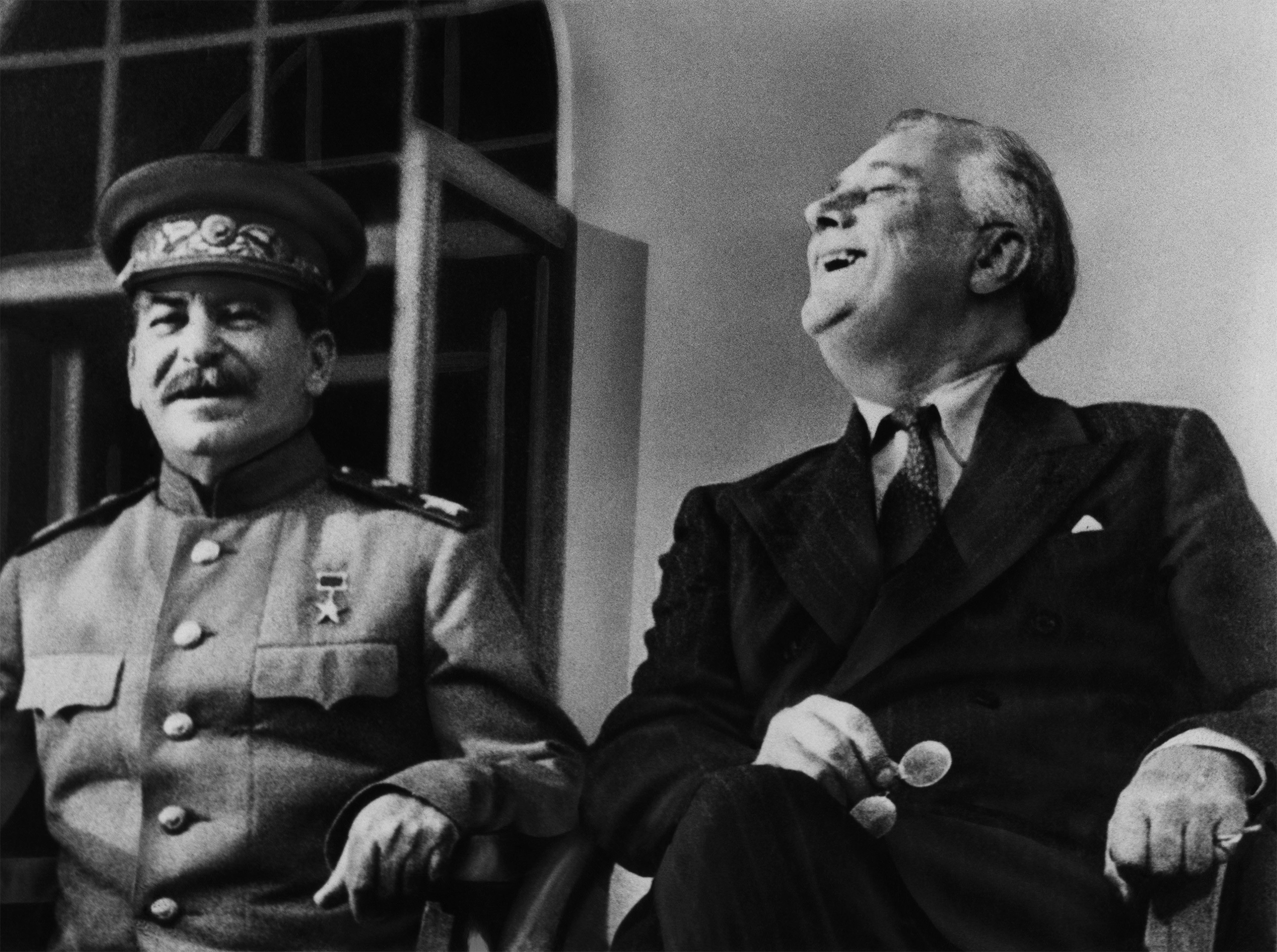 Soviet Premier Josef Stalin and US President Franklin Delano Roosevelt appear on the porch of the Russian embassy in Tehran, Iran in 1943.