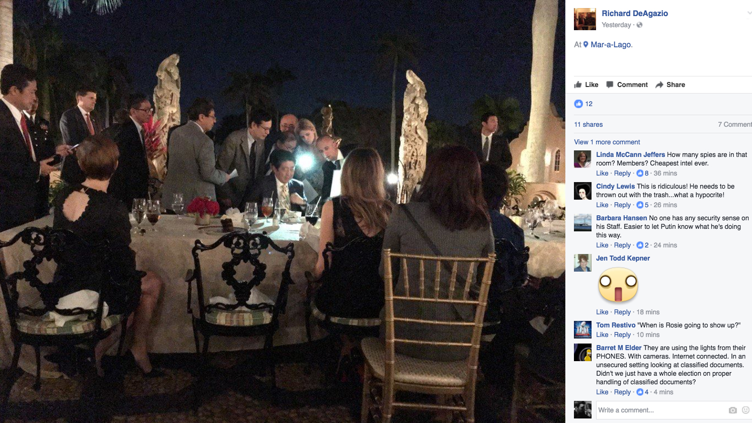 A screengrab of a photo posted on the Facebook page of Richard DeAgazio was said to show Japanese Prime Minister Shinzo Abe huddling with staffers during dinner at President Trump's Mar-a-Lago residence after news spread about North Korea's missile launch.