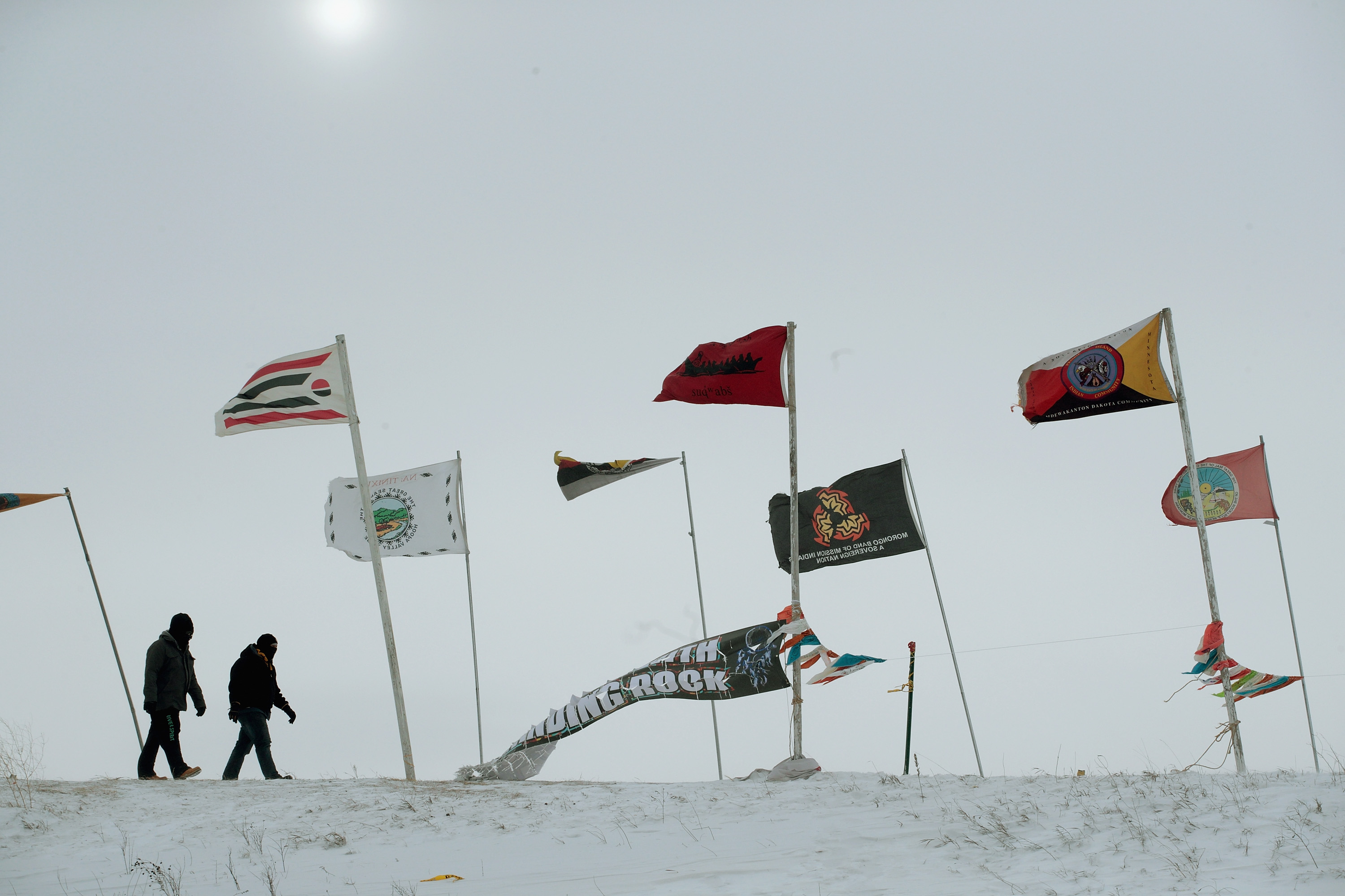 Activists fight the wind as they walk along Flag Road in Oceti Sakowin Camp as blizzard conditions grip the area around the Standing Rock Sioux Reservation on Dec. 6, 2016 outside Cannon Ball, North Dakota.