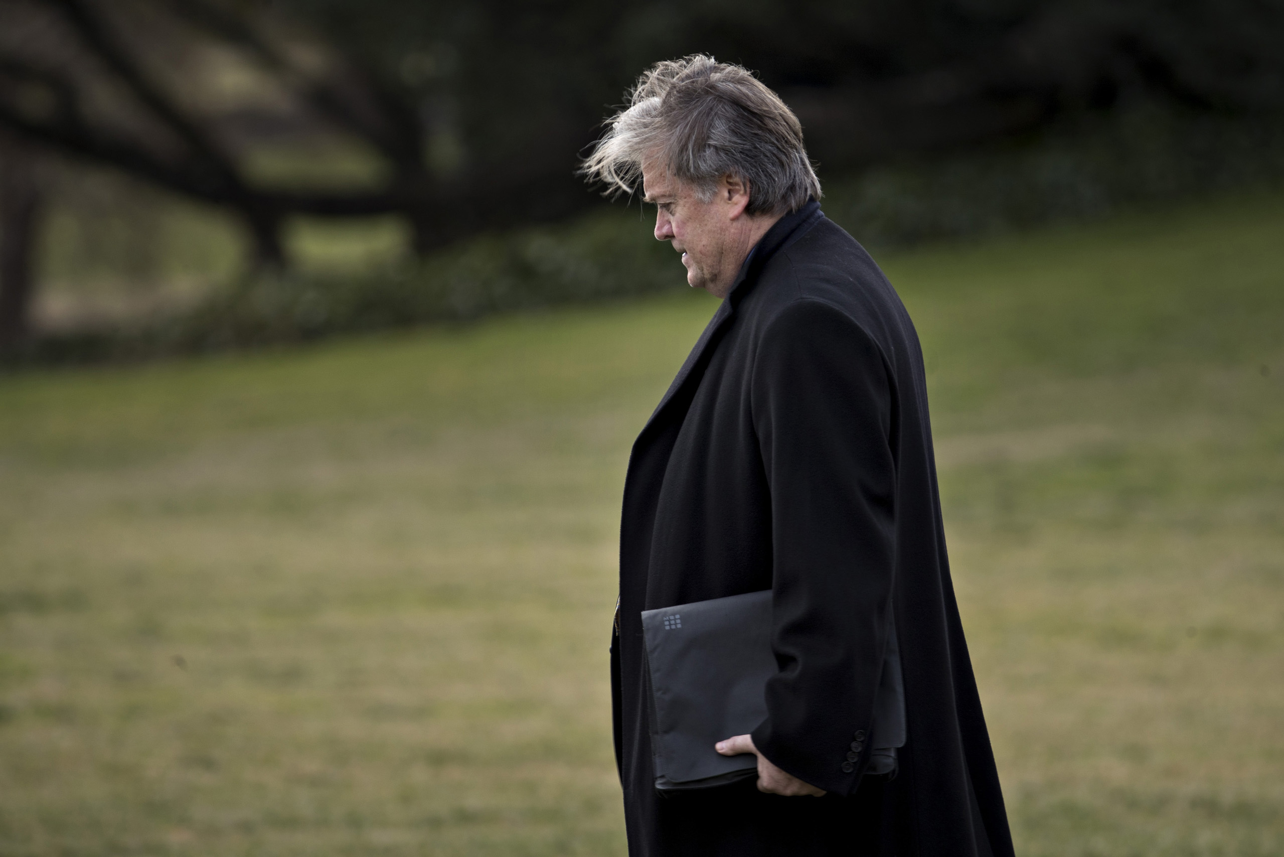 Steve Bannon, chief strategist for U.S. President Donald Trump, walks towards Marine One after Trump, not pictured, boarded on the South Lawn of the White House in Washington, D.C., Jan. 27, 2017.