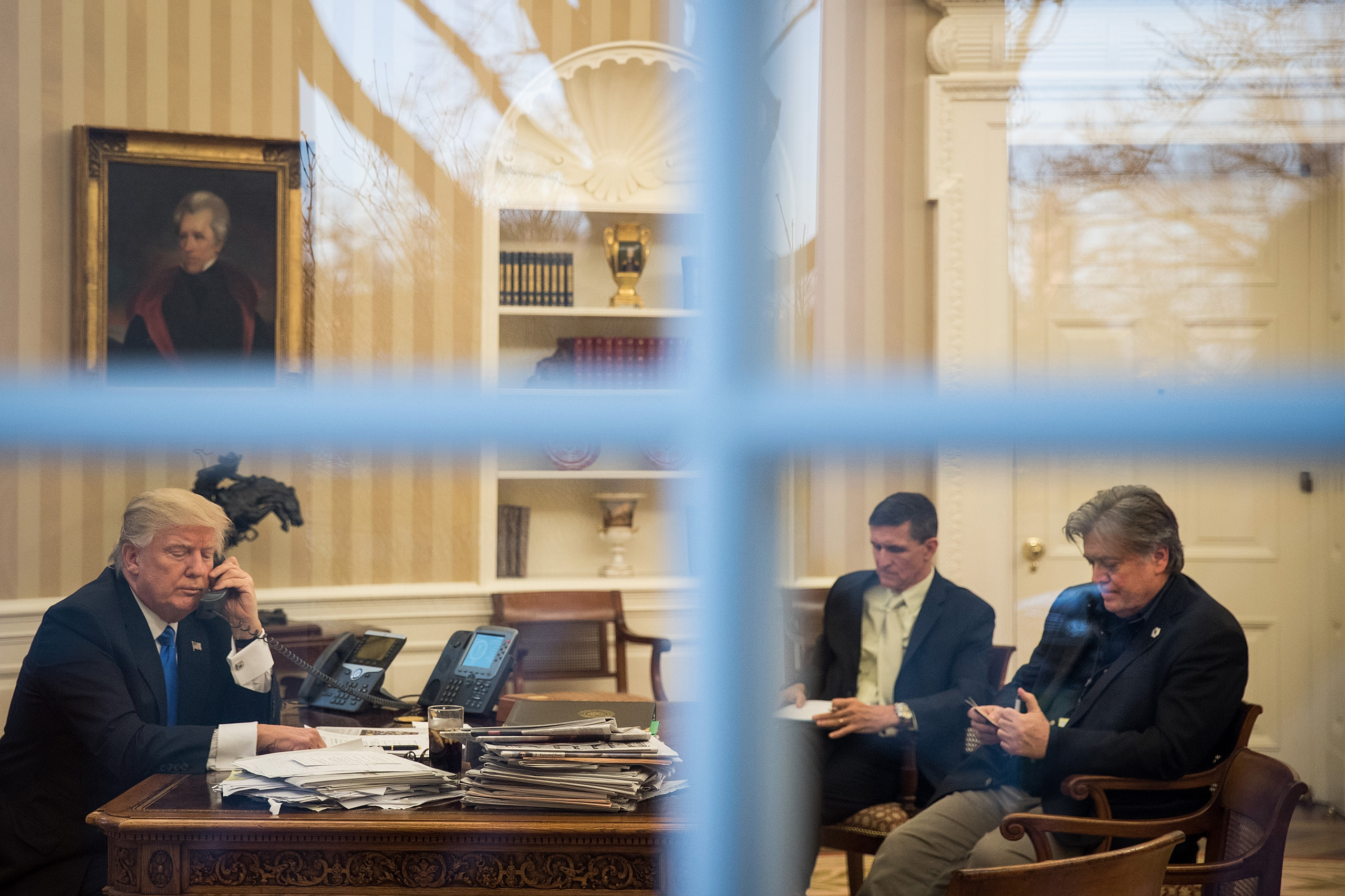 National security advisor Michael Flynn and White House chief strategist Steve Bannon in the Oval Office with President Trump while he speaks on the phone with Australian Prime Minister Malcolm Turnbull on Jan. 28, 2017.