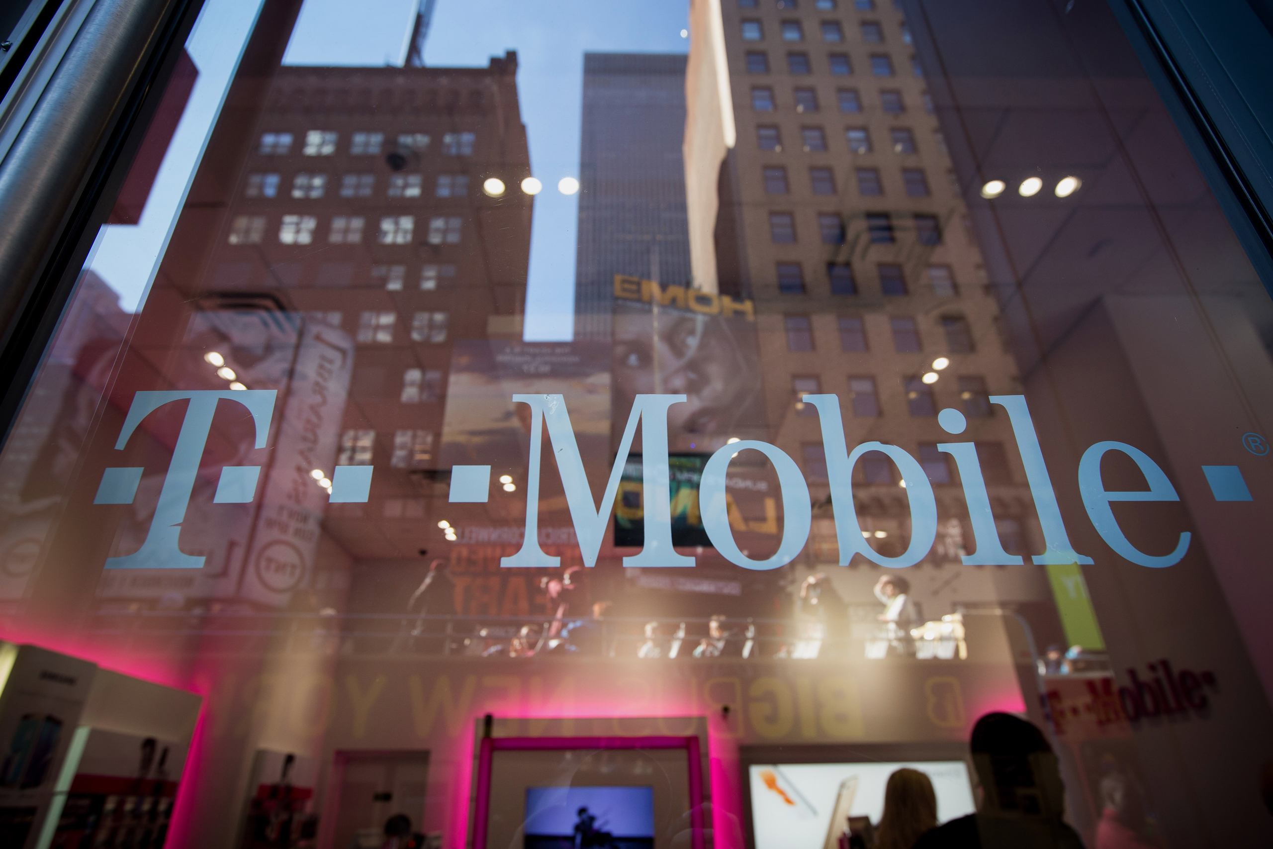 The T-Mobile US Inc. logo is displayed on a door at a T-Mobile US Inc. store in New York on Oct. 26, 2015.