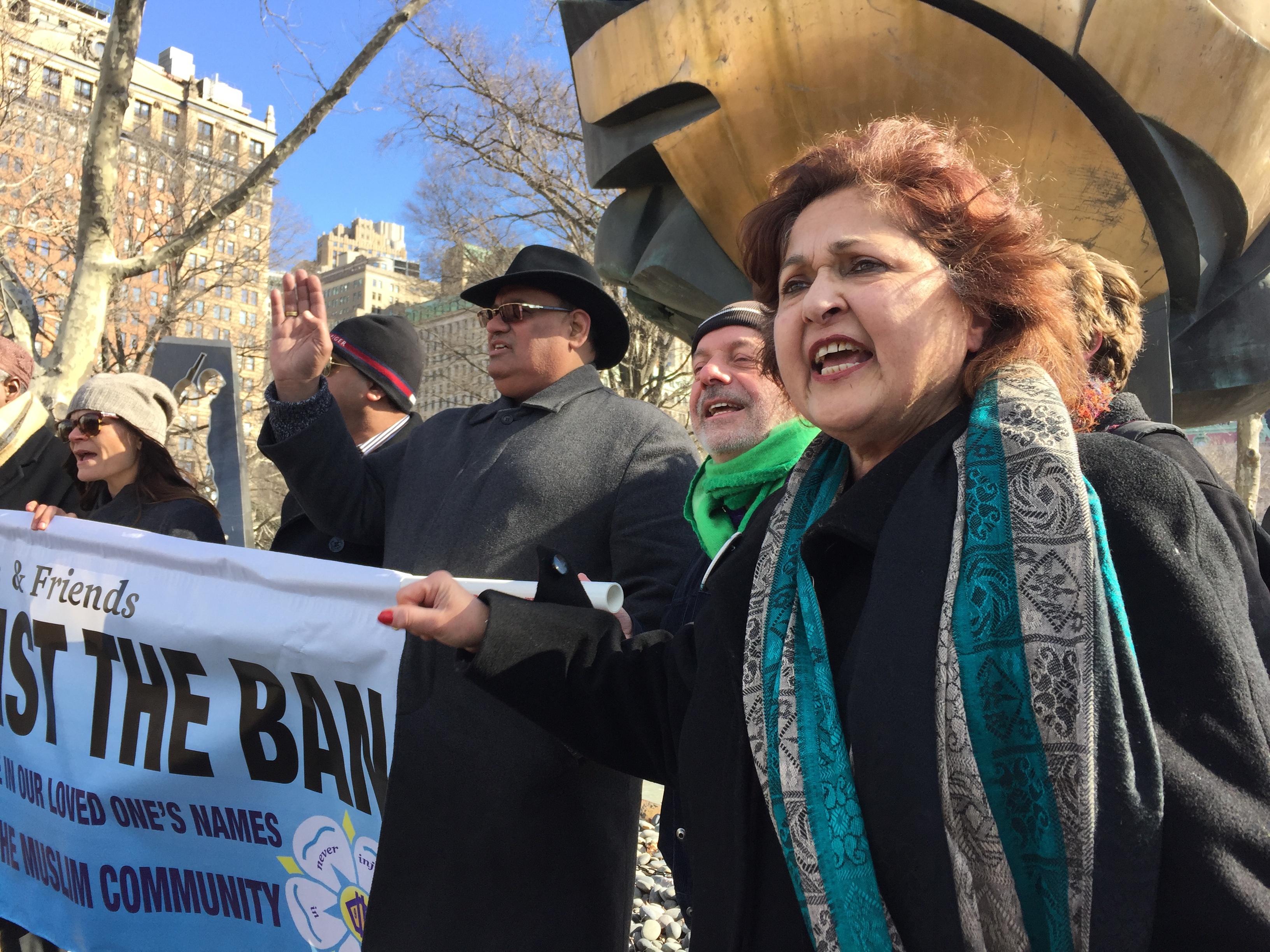 Talat Hamdani (right) and other family members of 9/11 victims rally against President Donald Trump's immigration order in New York City on Feb. 16, 2017.