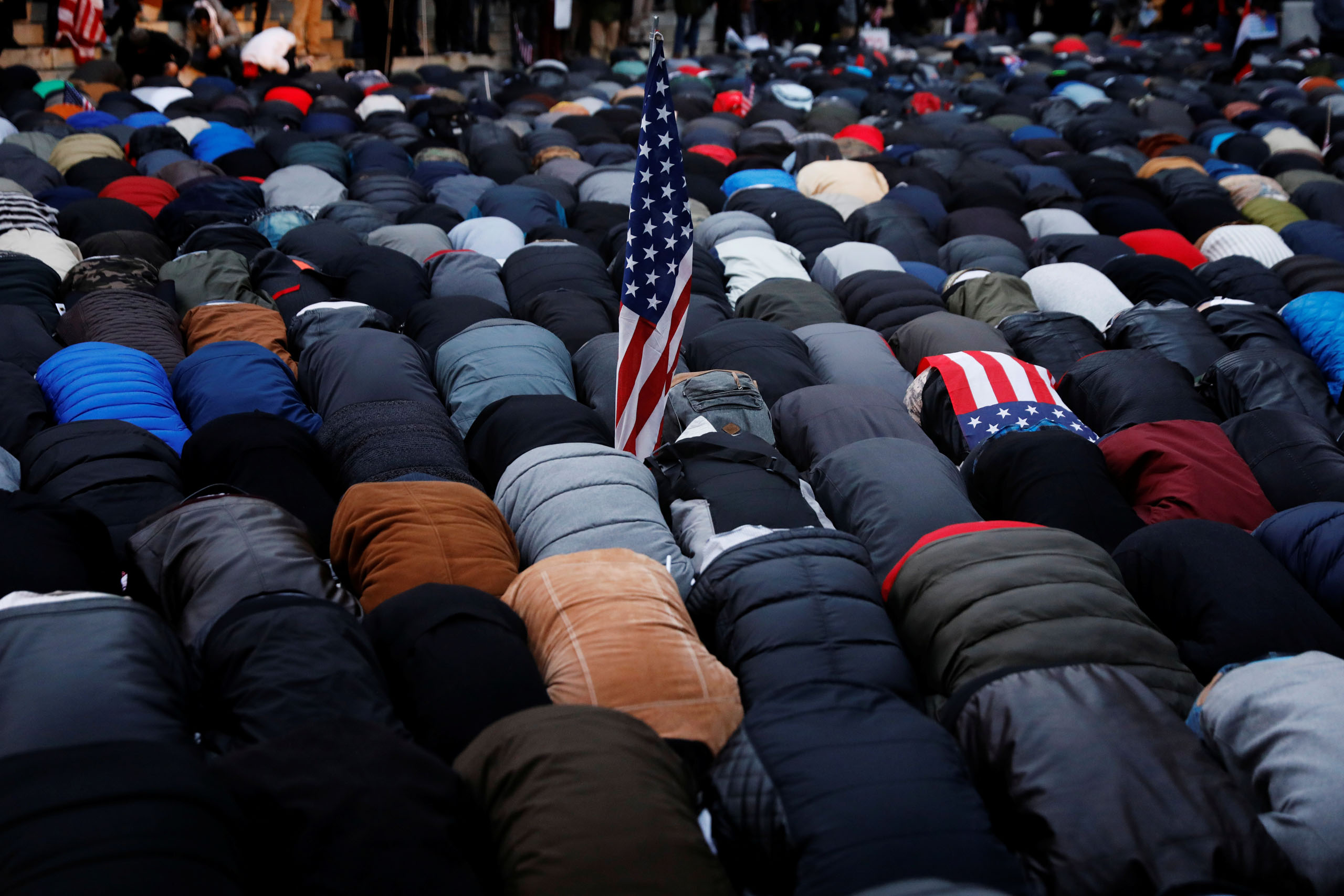 Demonstrators pray as they participate in a protest by the Yemeni community against President Donald Trump's travel ban in the Brooklyn borough of New York, on Feb. 2, 2017.