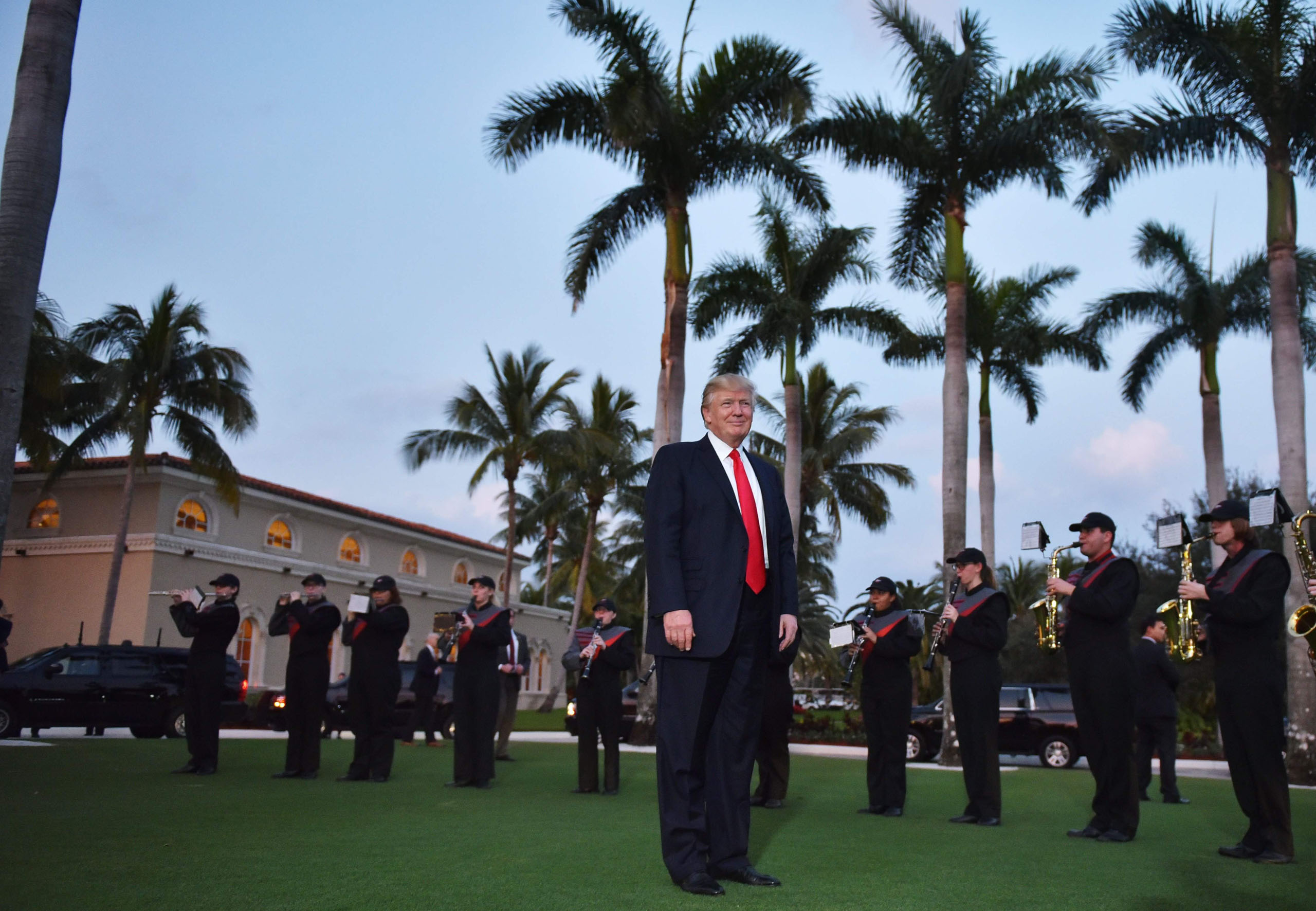 President Donald Trump watches the Palm Beach Central High School marching band which greeted him as he arrived to watch the Super Bowl at Trump International Golf Club Palm Beach in West Palm Beach, Florida on Feb. 5, 2017.