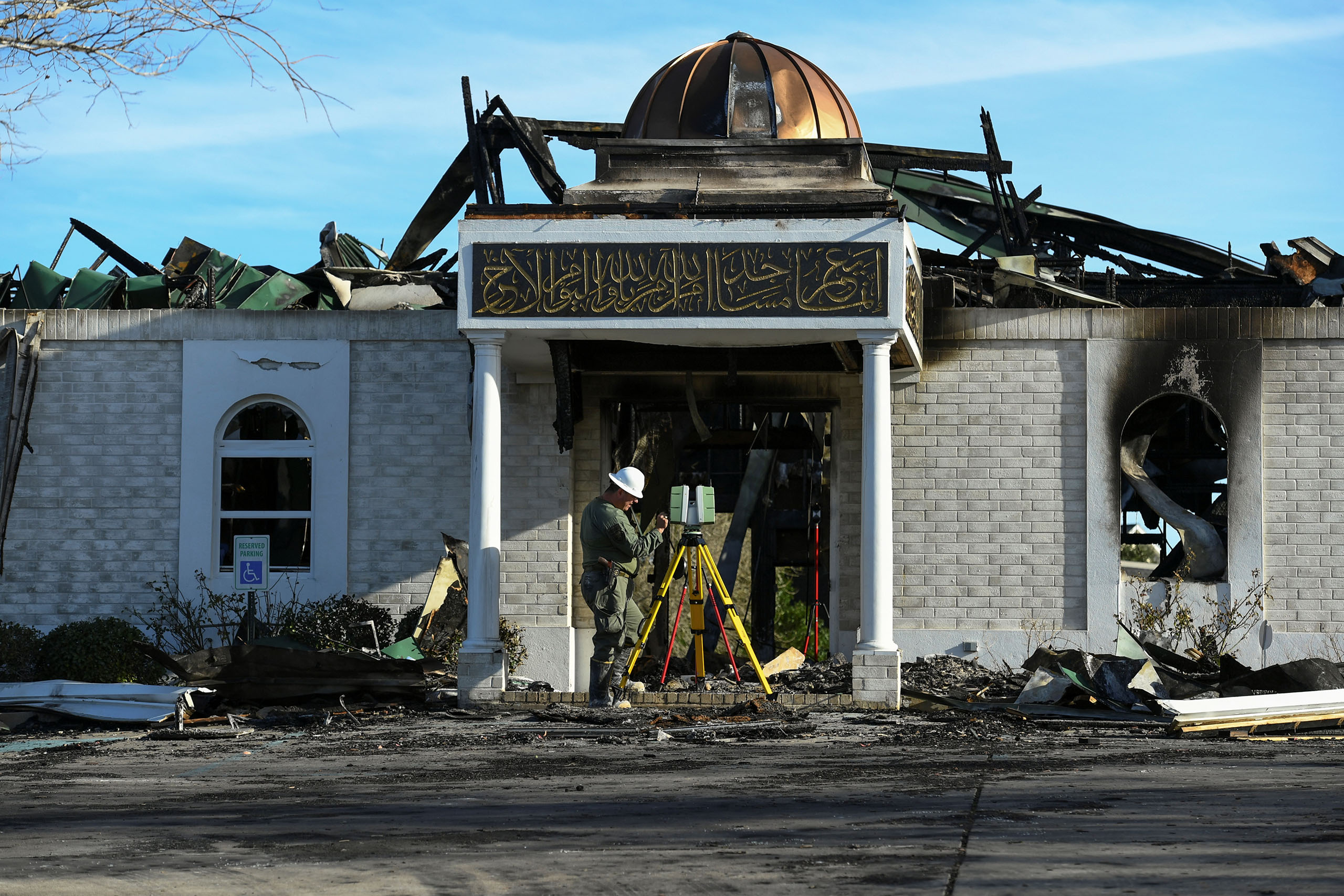 A security official investigates the aftermath of a fire at the Victoria Islamic Center mosque in Victoria, Texas, on Jan. 29, 2017.