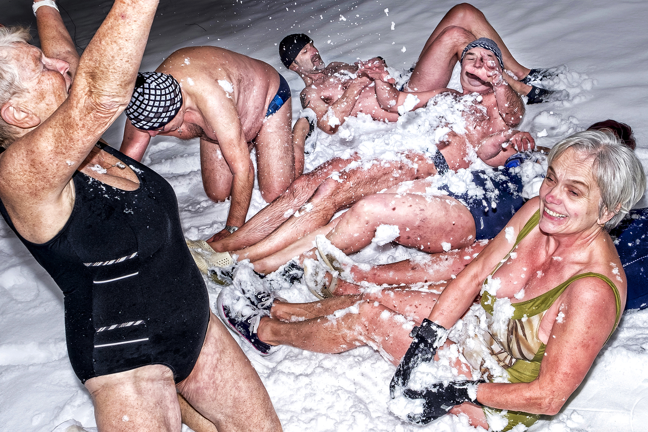 Pardubice cold water swimmers, pictured on Jan. 2 2017, often finish their meet ups by rolling in the snow.