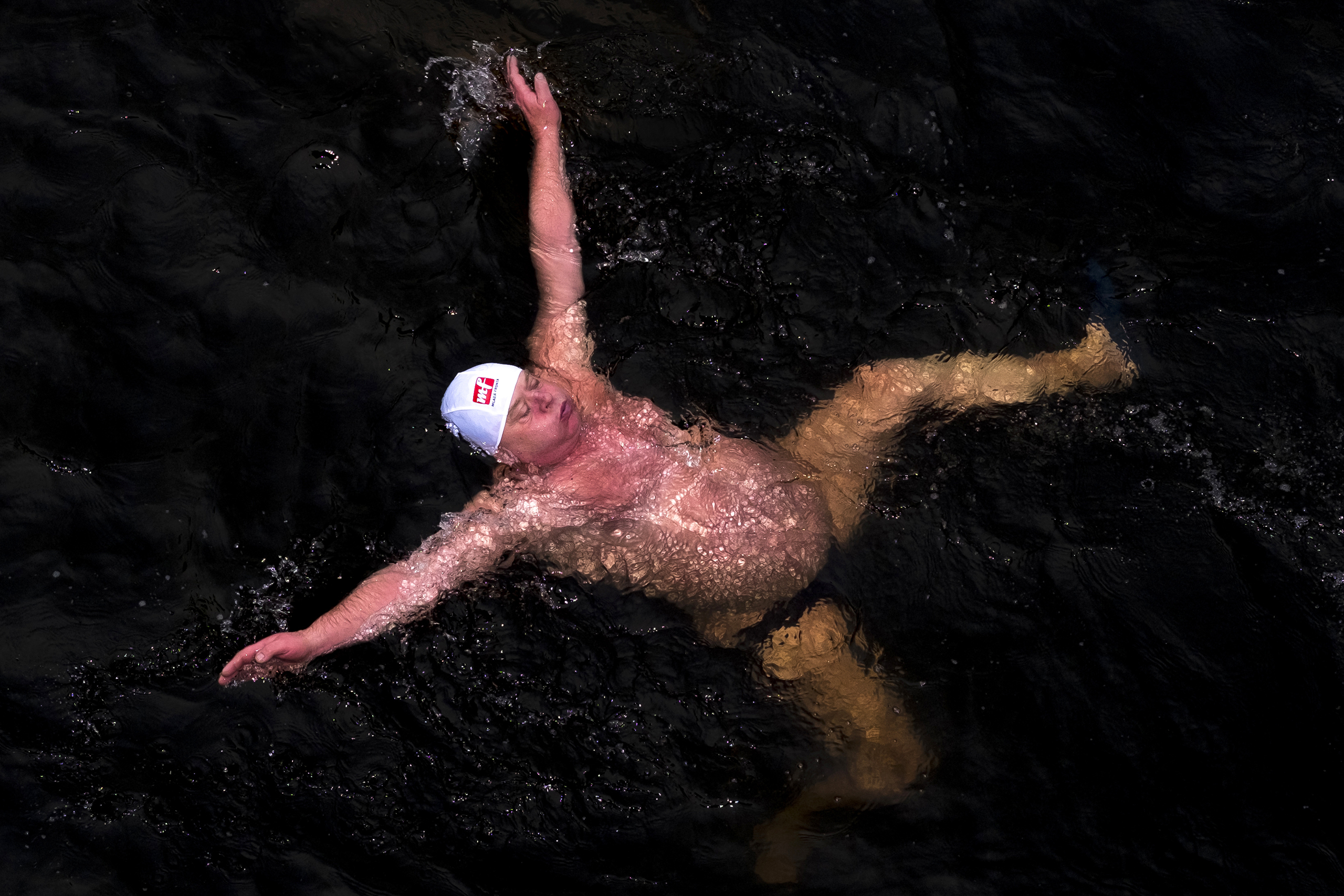 A swimmer takes part in a Boxing Day cold water swim in Prague's Vltava River on Dec. 26 2016.
