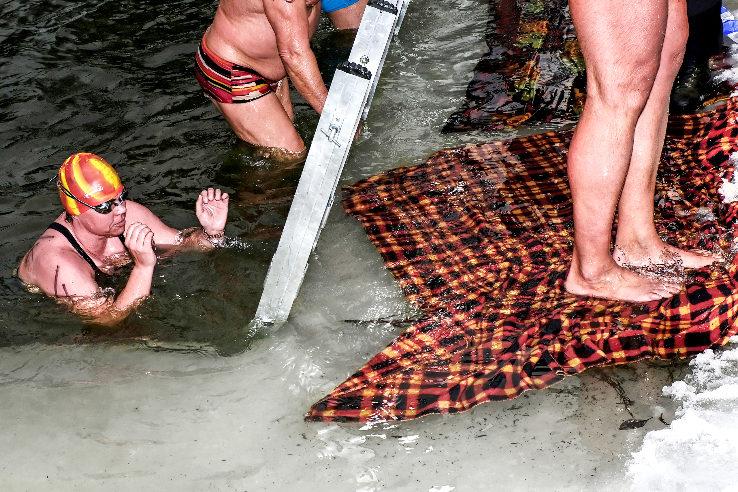 Blankets like this one, pictured on Feb. 18 2017 by a pond in Sázava, in the Czech Republic, prevent cold water swimmers from slipping on slippery ice.