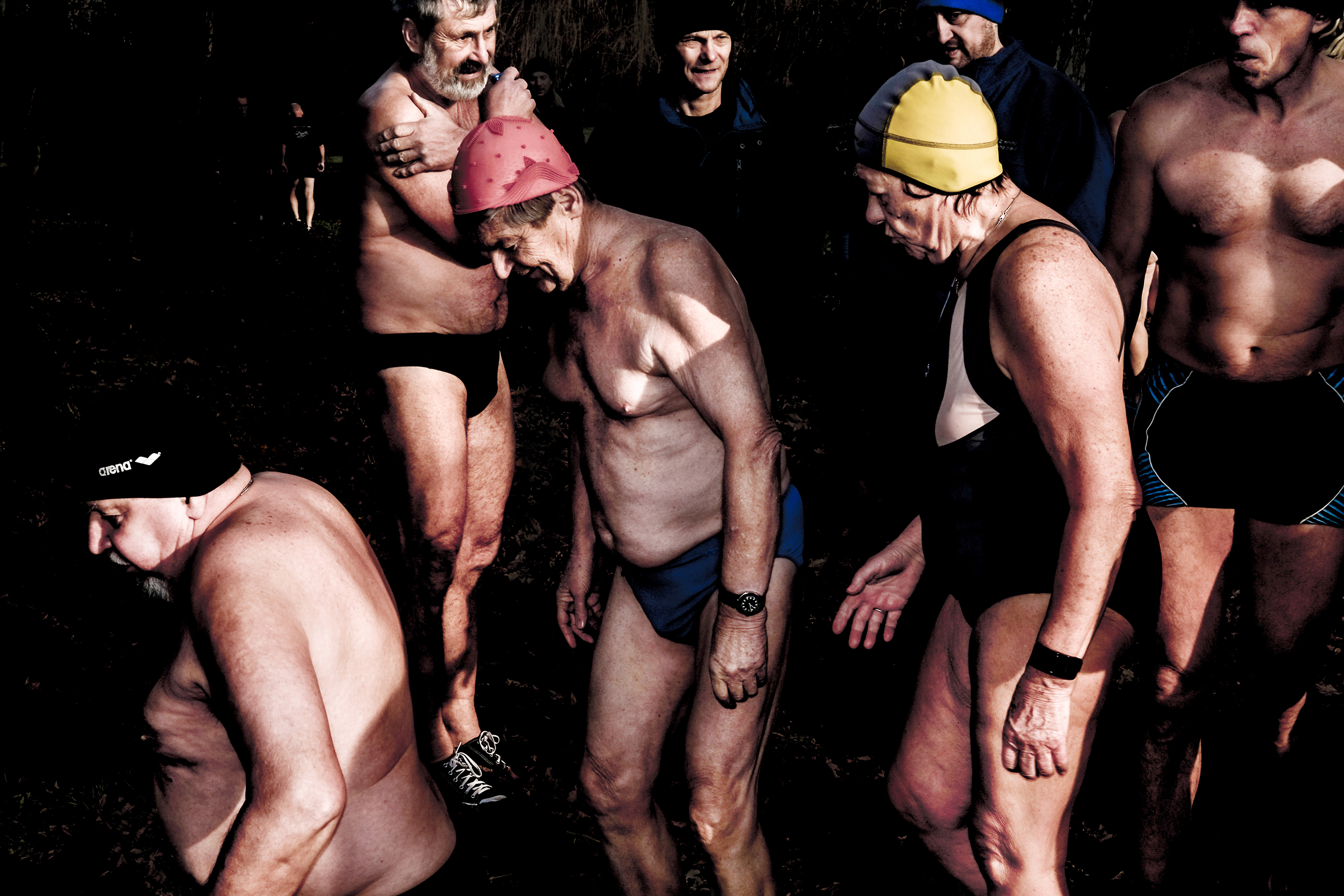 A group of senior cold water swimmers stand by the Orlice River on Oct. 10 2016.
