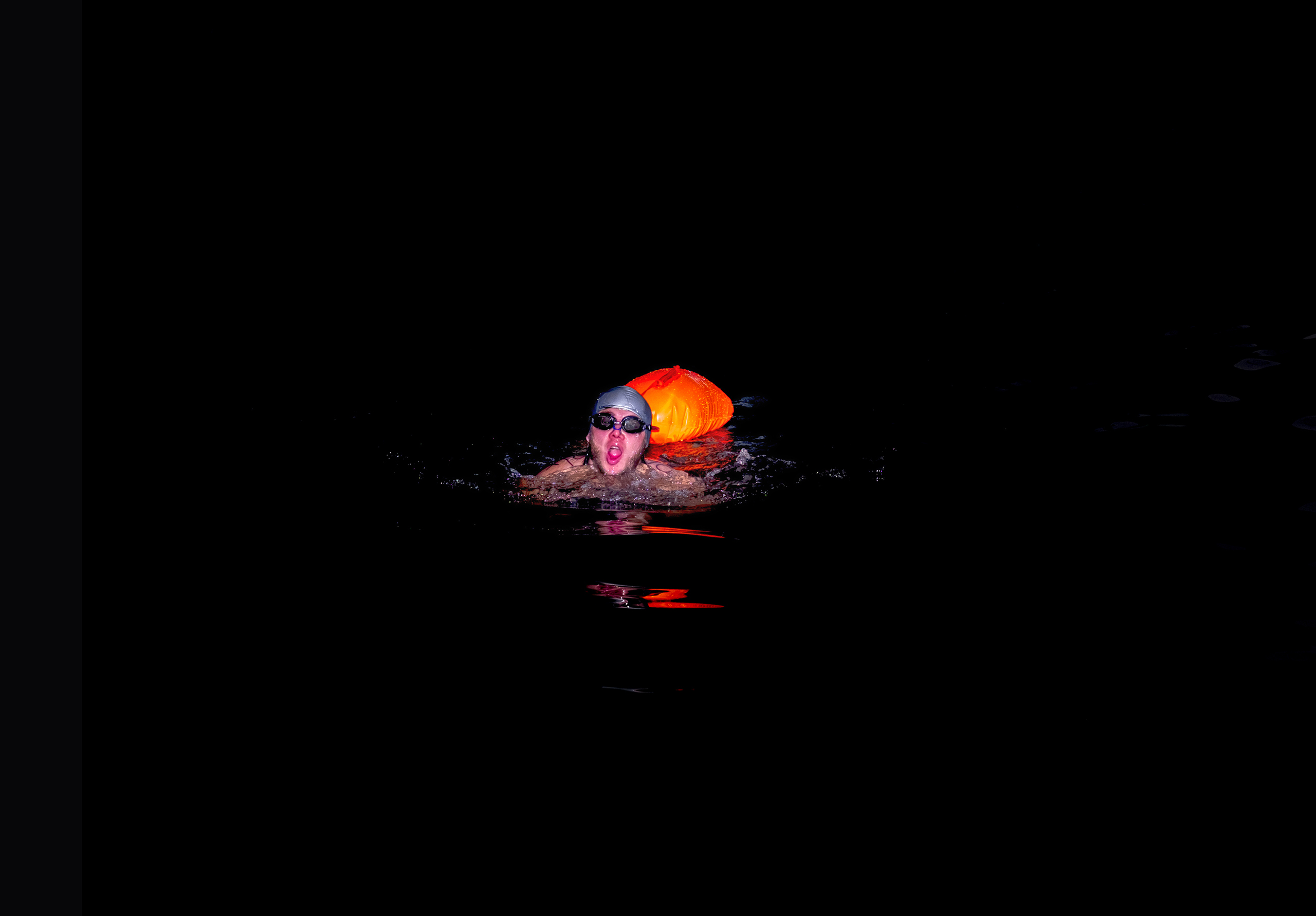 A swimmer in the Labe River on Dec. 17 2016. Some competitions ensure swimmers take to the water accompanied with a rescue buoy.