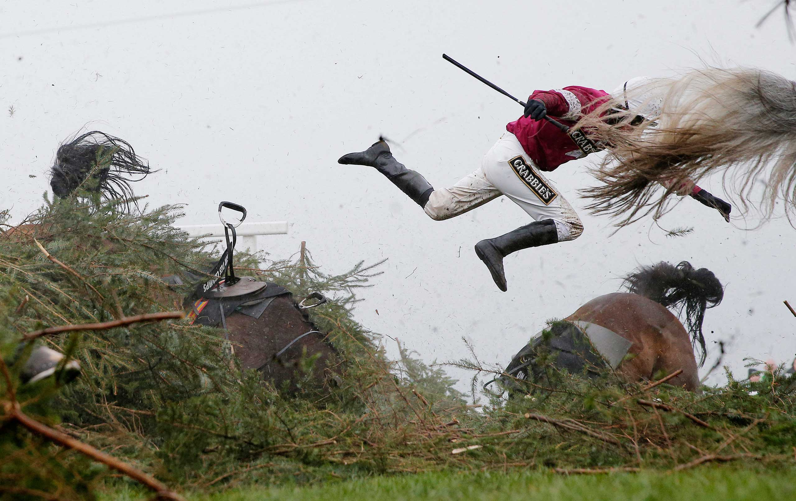 Jockey Nina Carberry flies off her horse Sir Des Champs as they fall at The Chair fence during the Grand National steeplechase during day three of the Grand National Meeting at Aintree Racecourse on April 9, 2016 in Liverpool, England.