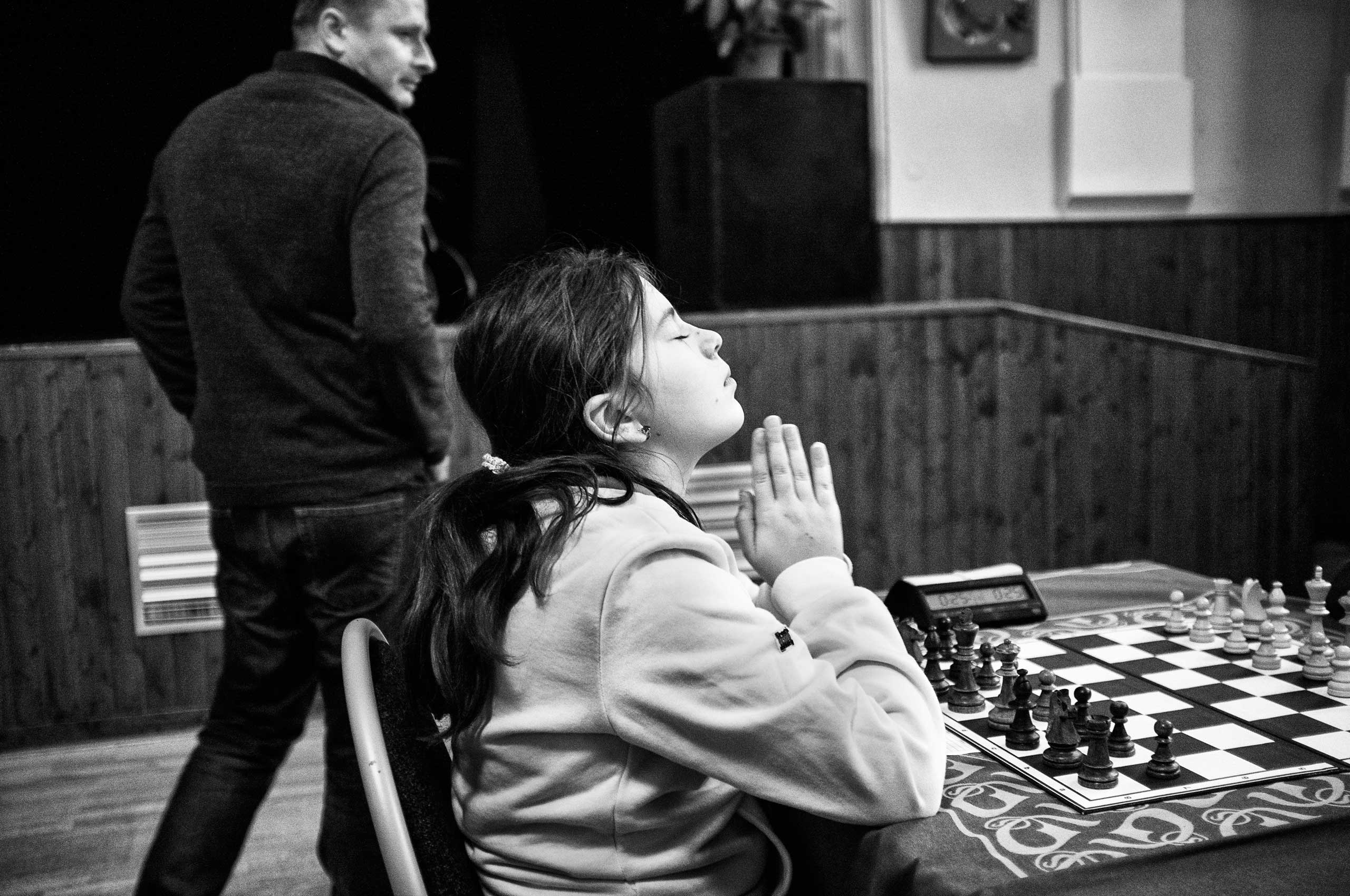 The chess player concentrates just a few moments before the start of the next round of a tournament.