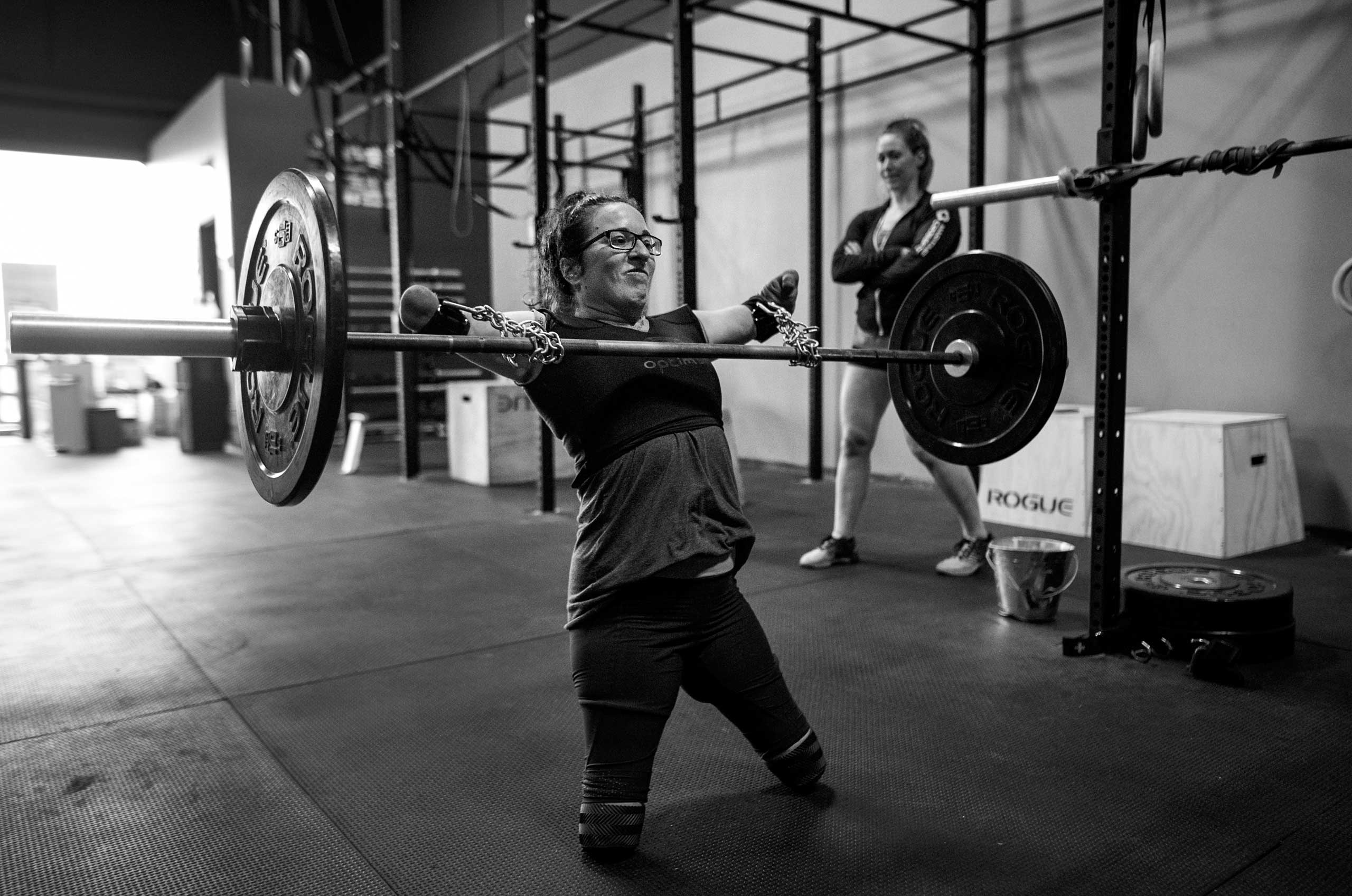 With the aid of chains purchased at the hardware store and deadlift straps, Lindsay performs snatches under the watchful eye of coach and co-owner of CrossFit OnSide Jenny Jeffries in Halifax, Nova Scotia, Canada on July 8, 2016.